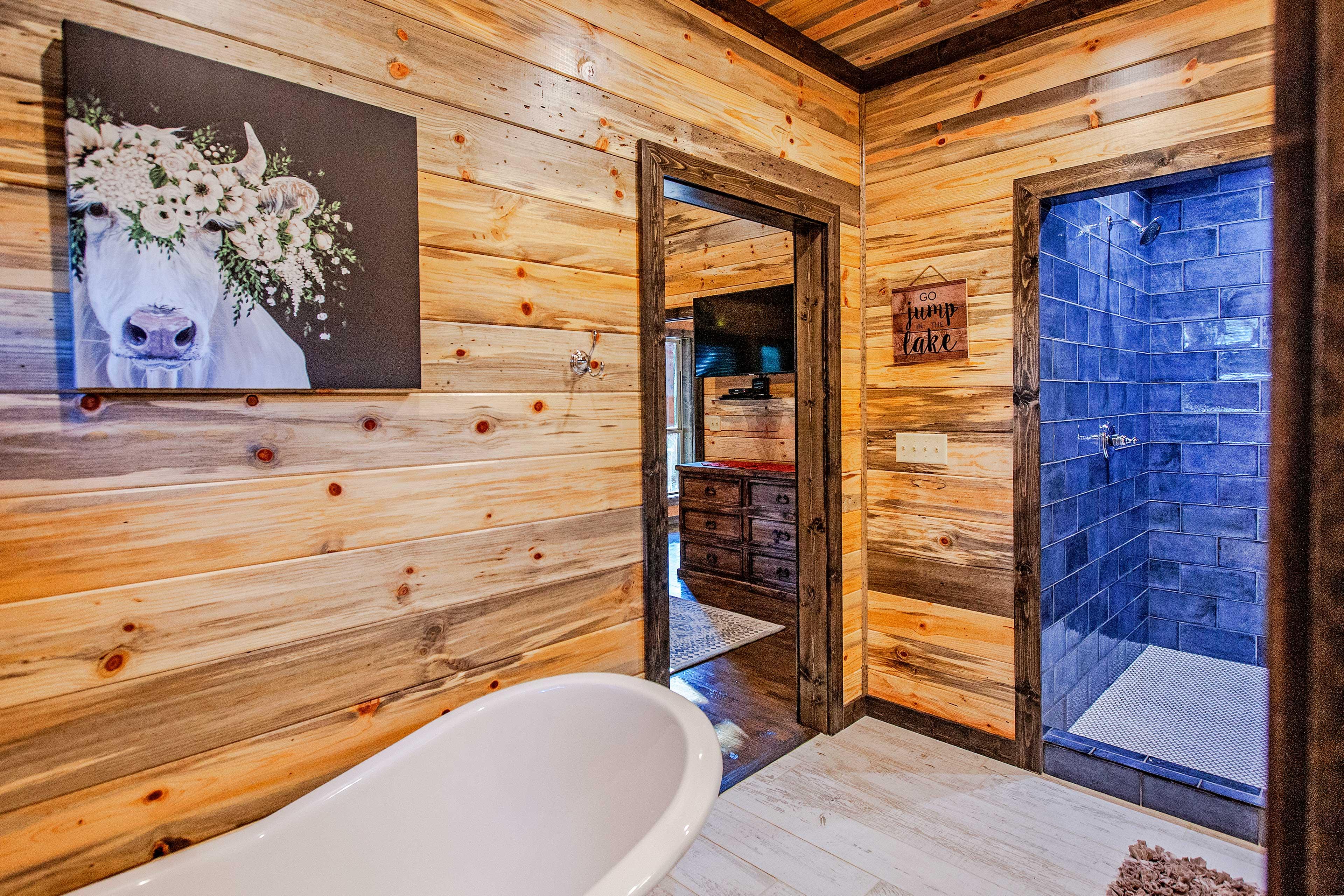 Contemporary Western-inspired artwork adorns the bathroom walls.