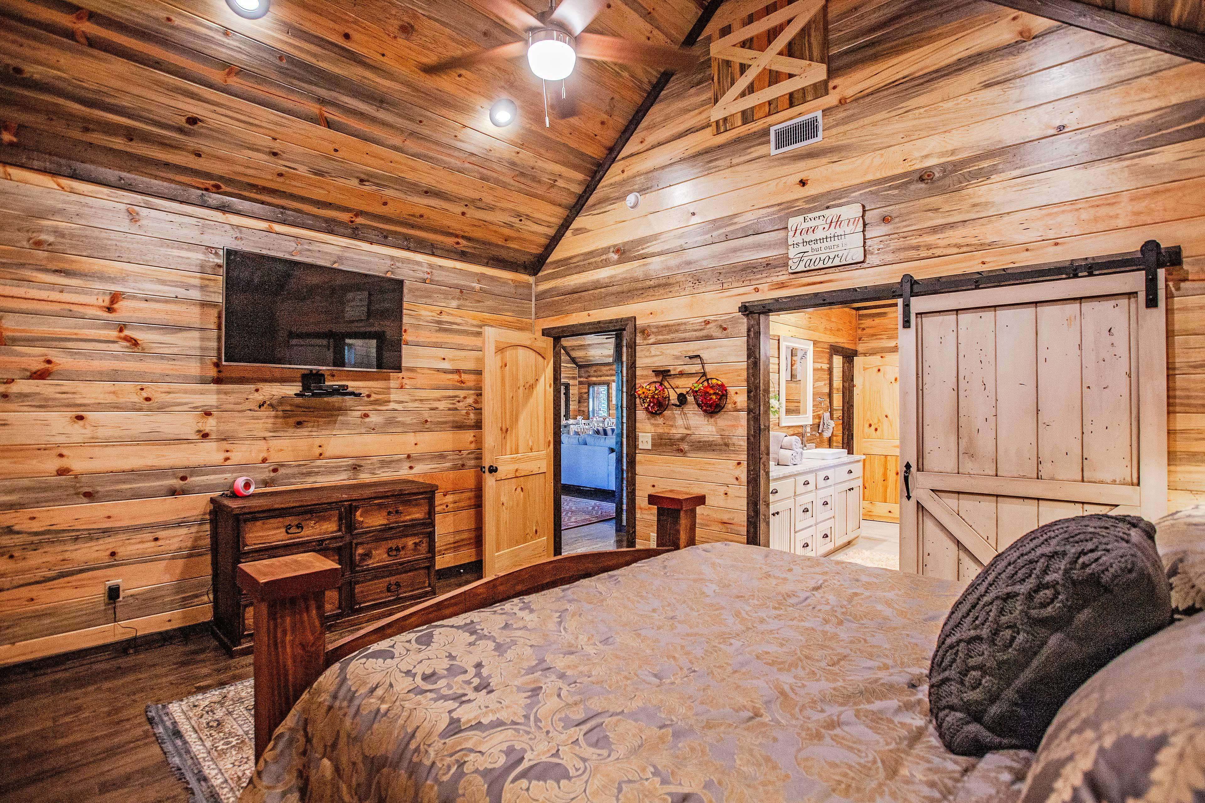 A chic sliding farmhouse door connects the bedroom & bathroom.