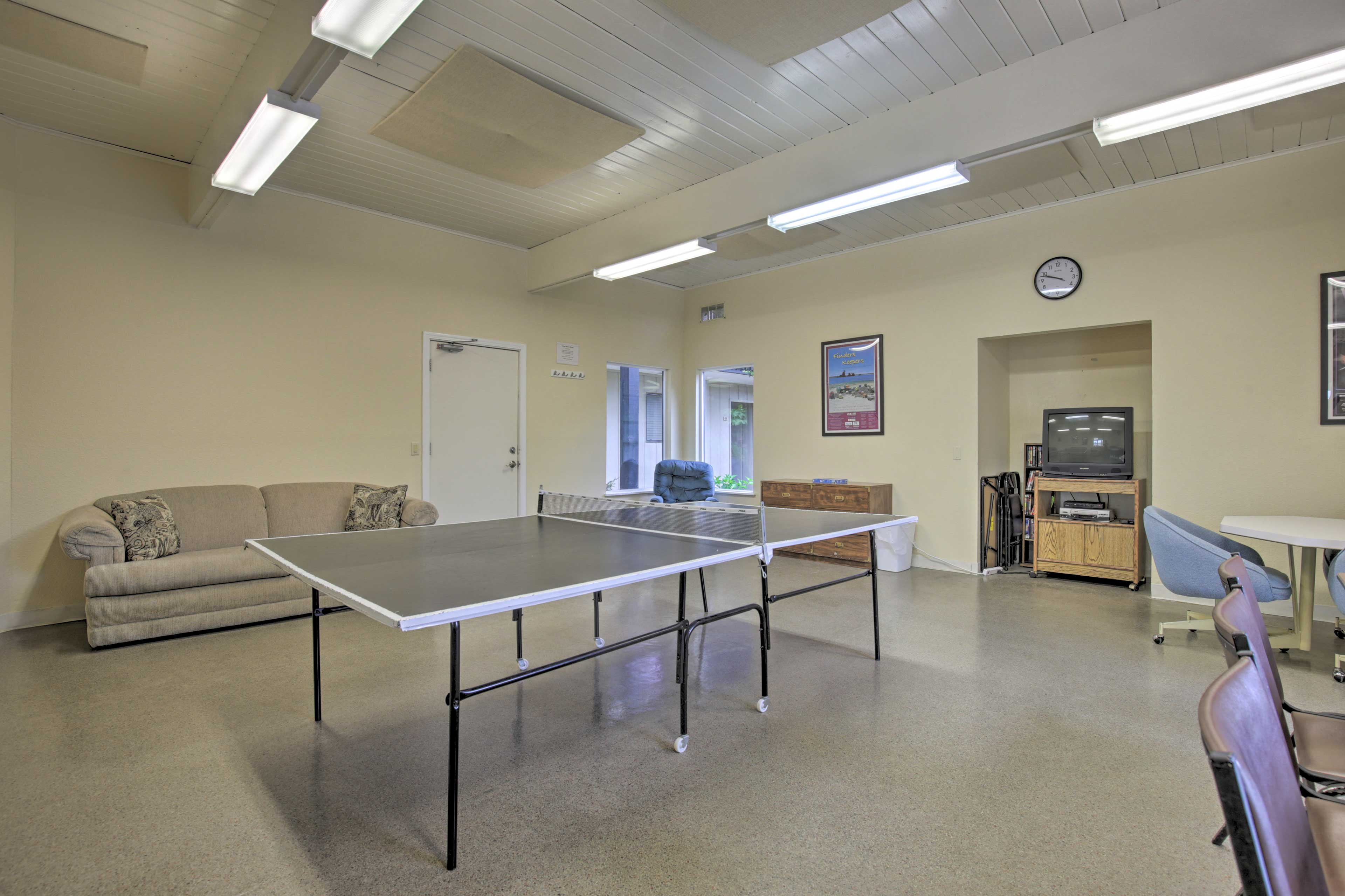 Play ping pong with friends old and new in the shared game room.
