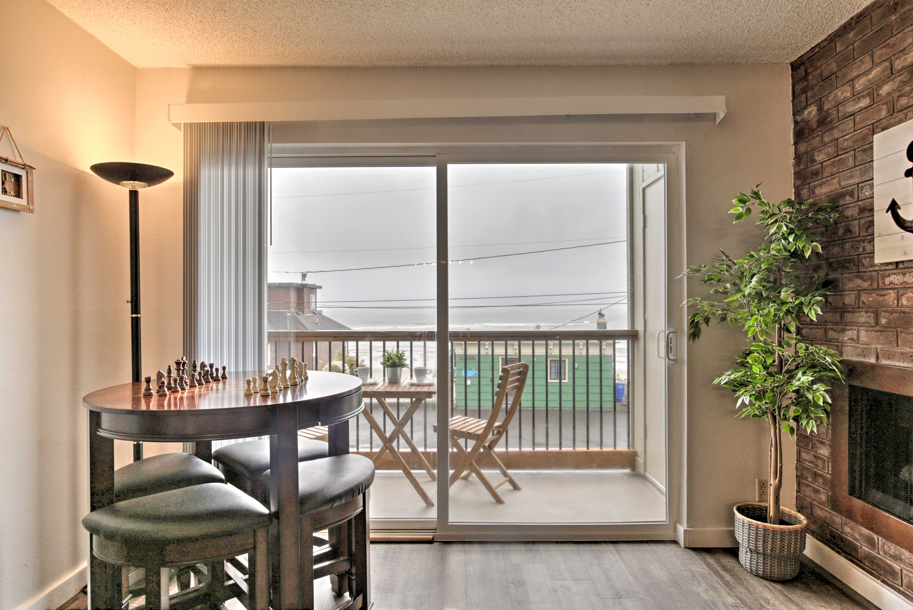 Enjoy meals or games of chess at this ocean-side table for 4.