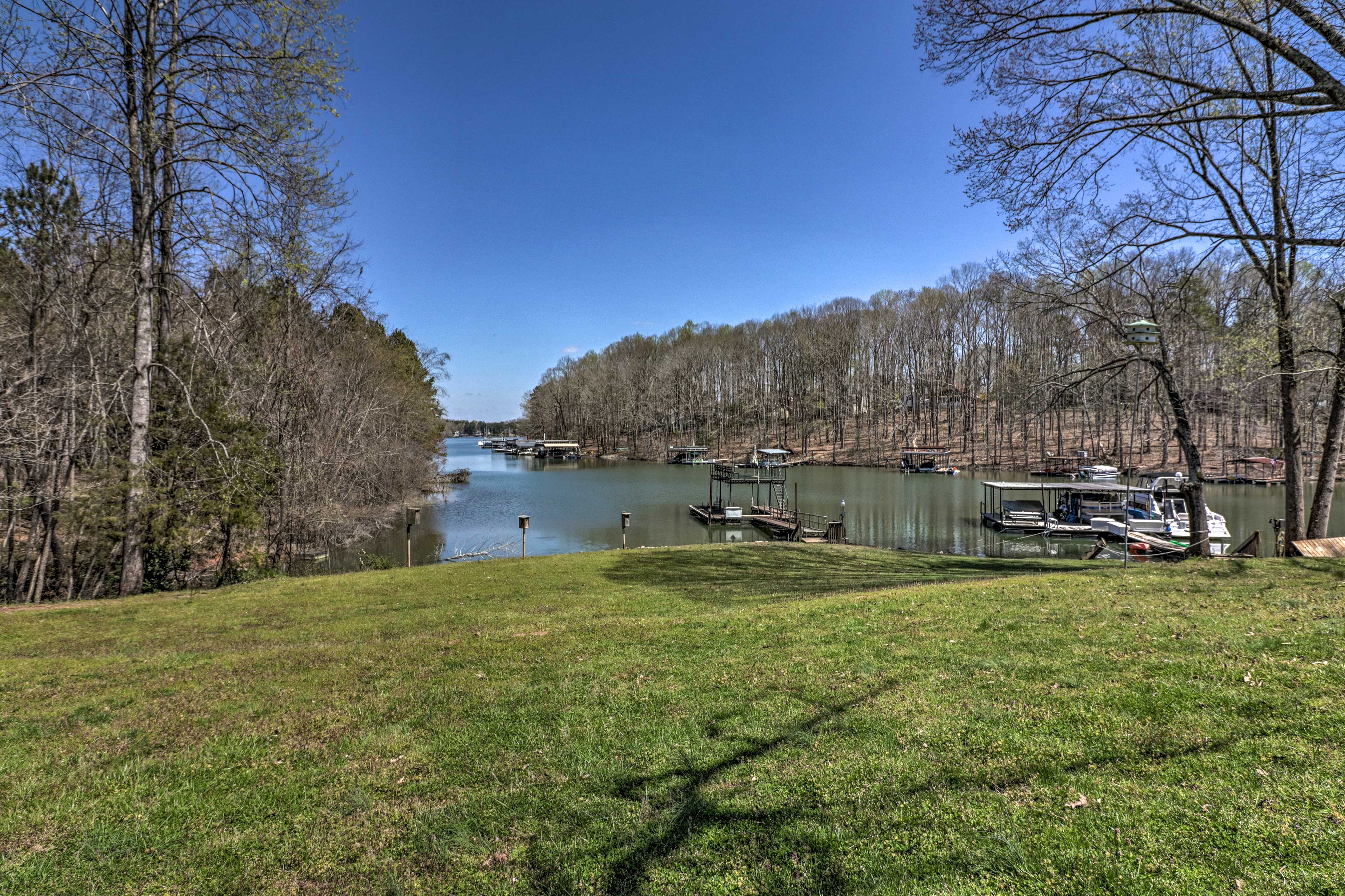The dock and boat slip are just down from the house.