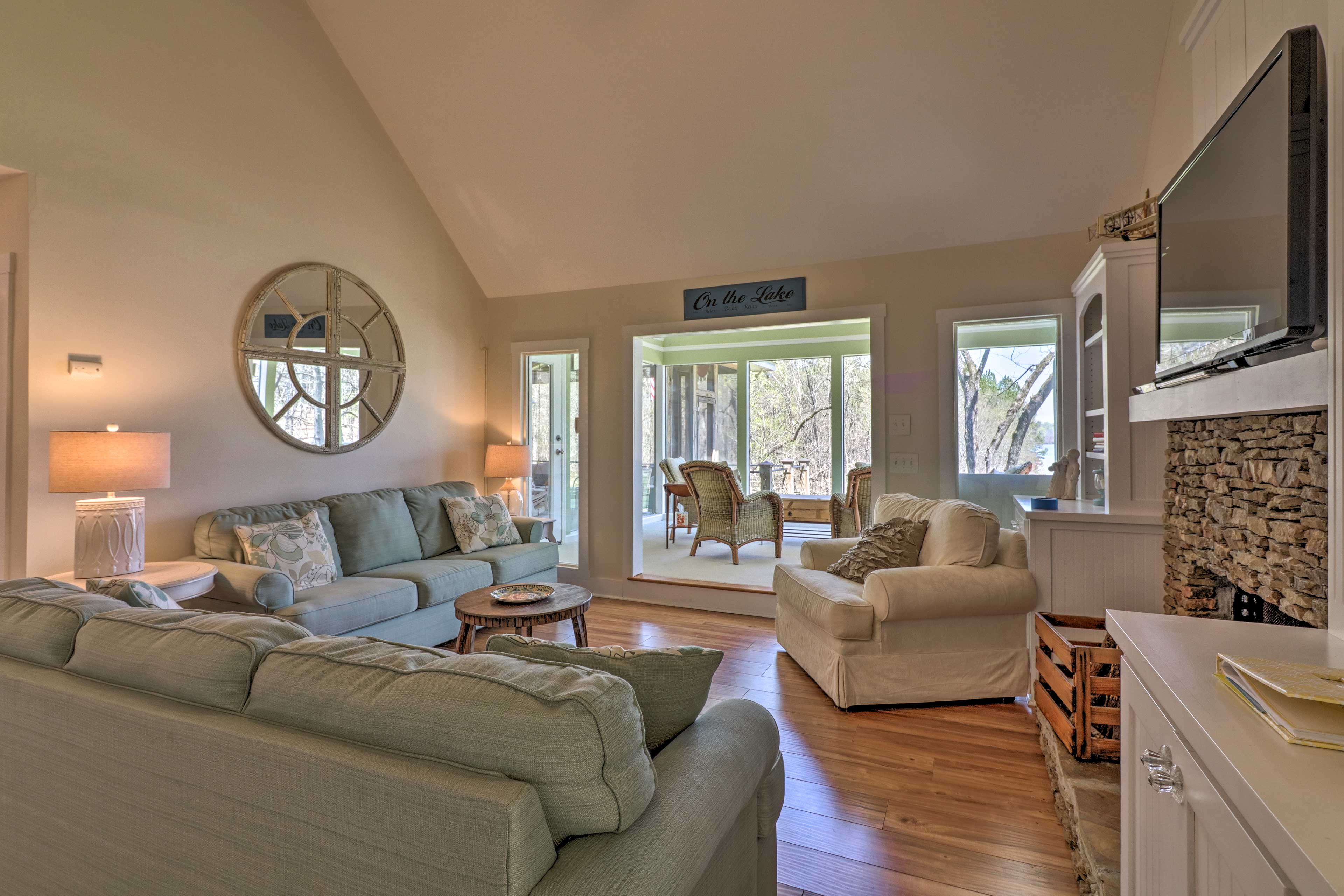Natural light pours in through large picture windows.