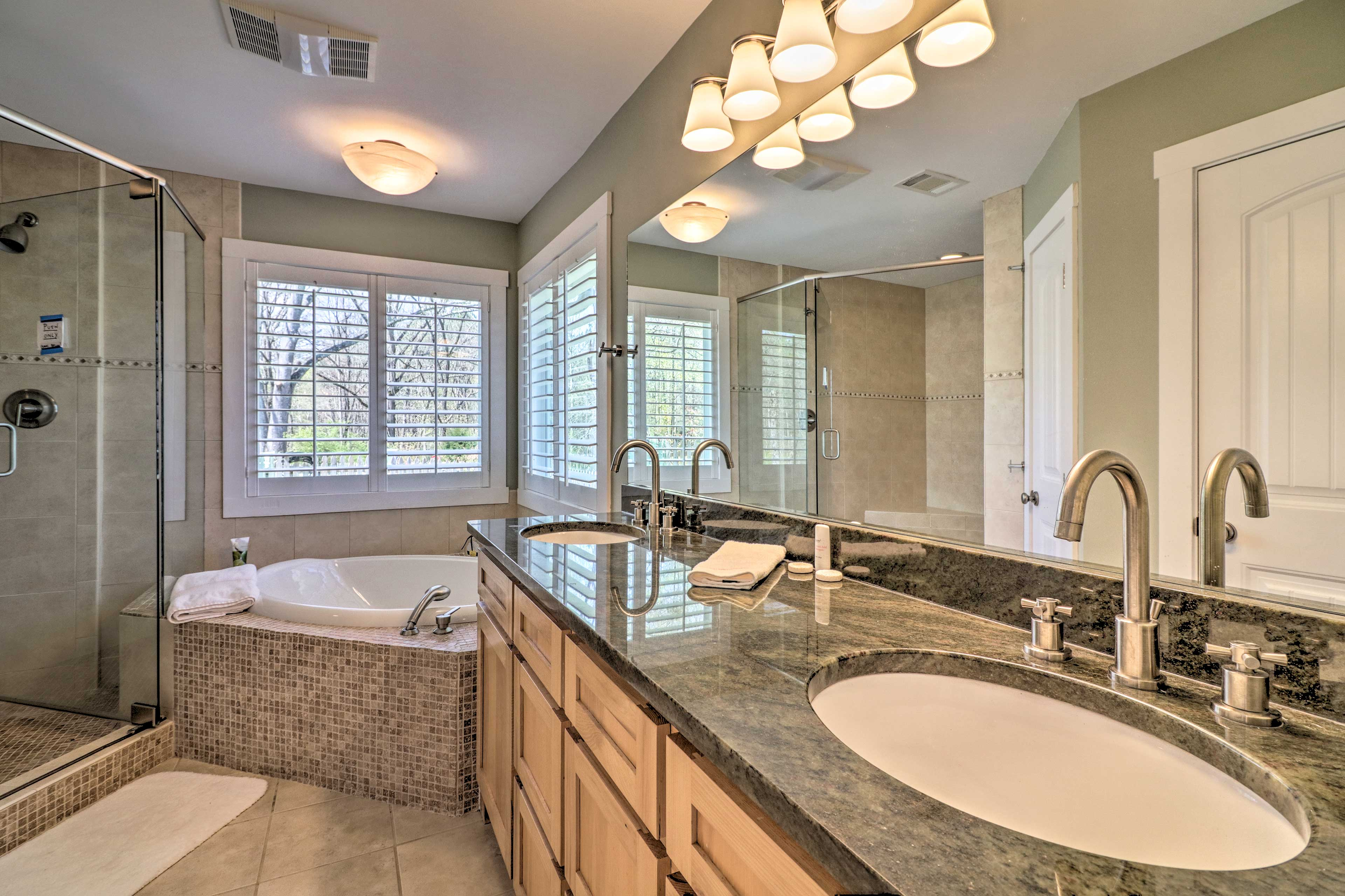 Dual sinks and a garden tub are just a couple of master bathroom highlights.