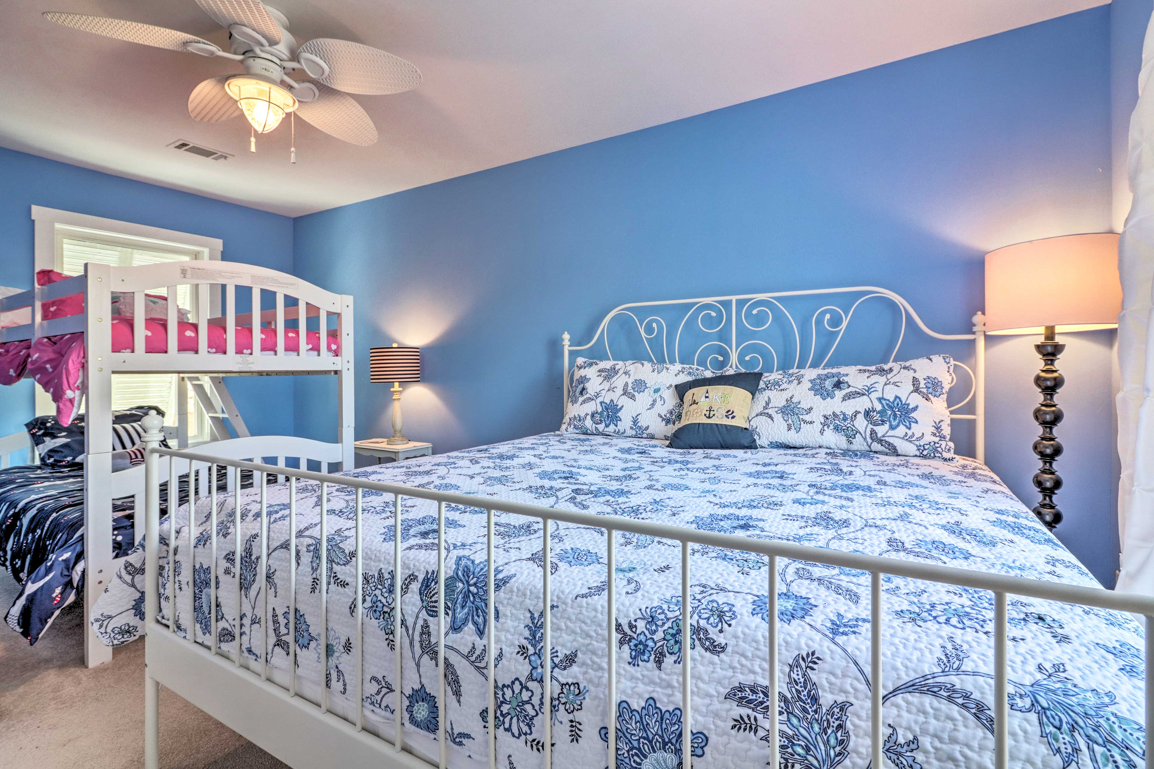 It features a king bed and twin-over-twin bunk bed.