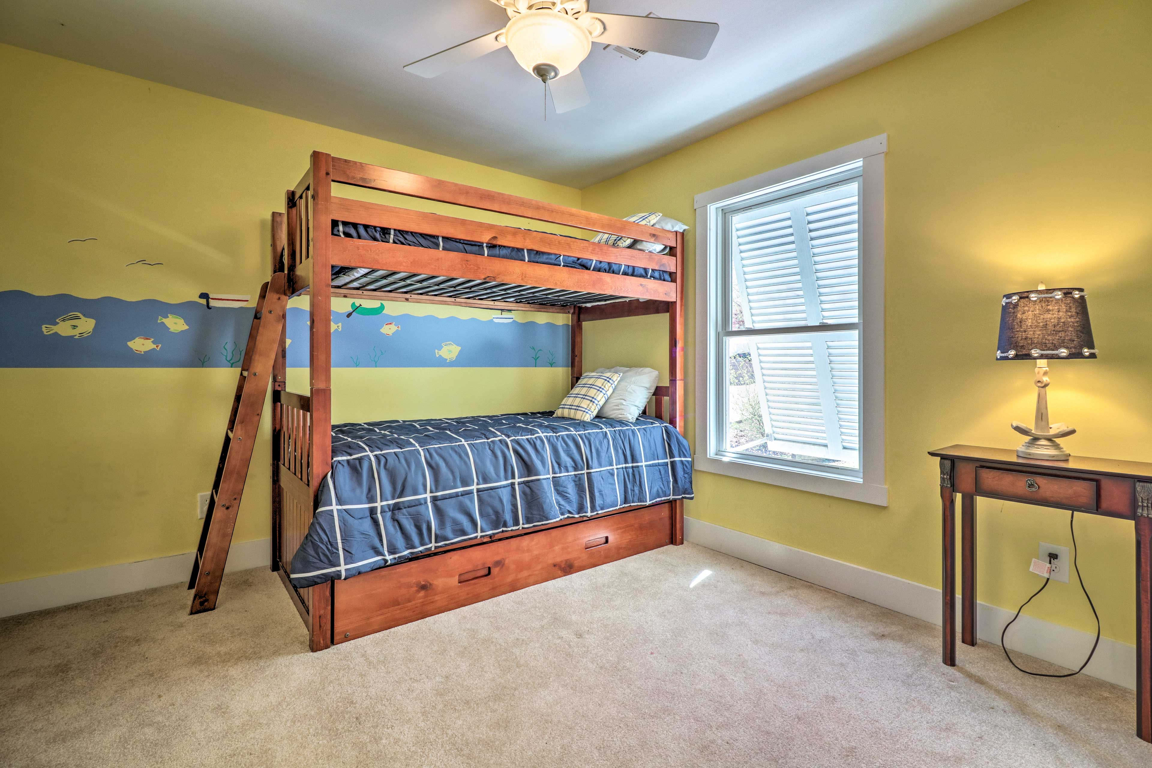 Tuck the kids to bed in this twin-over-twin bunk bed.