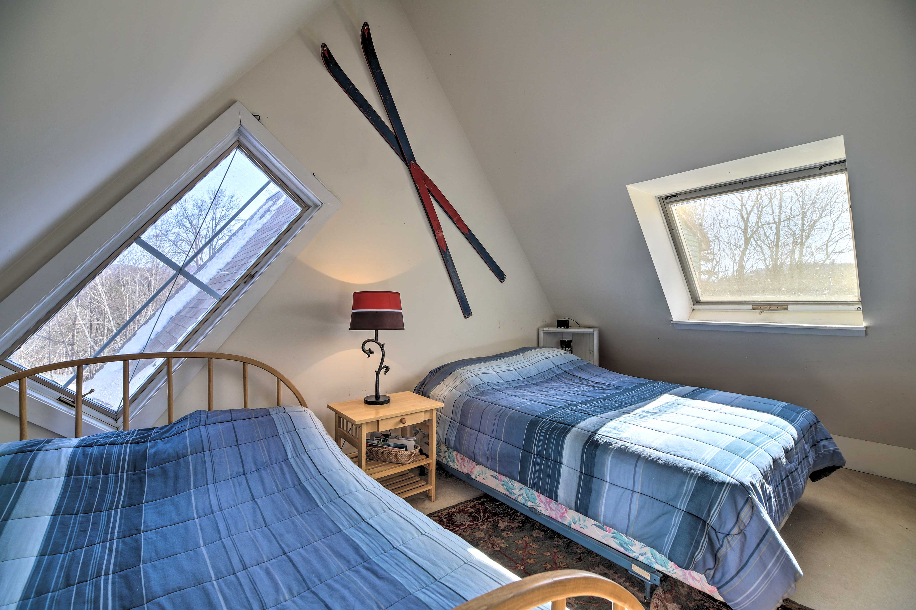 Upstairs, this bedroom sleeps 4 guests in the 2 queen beds.