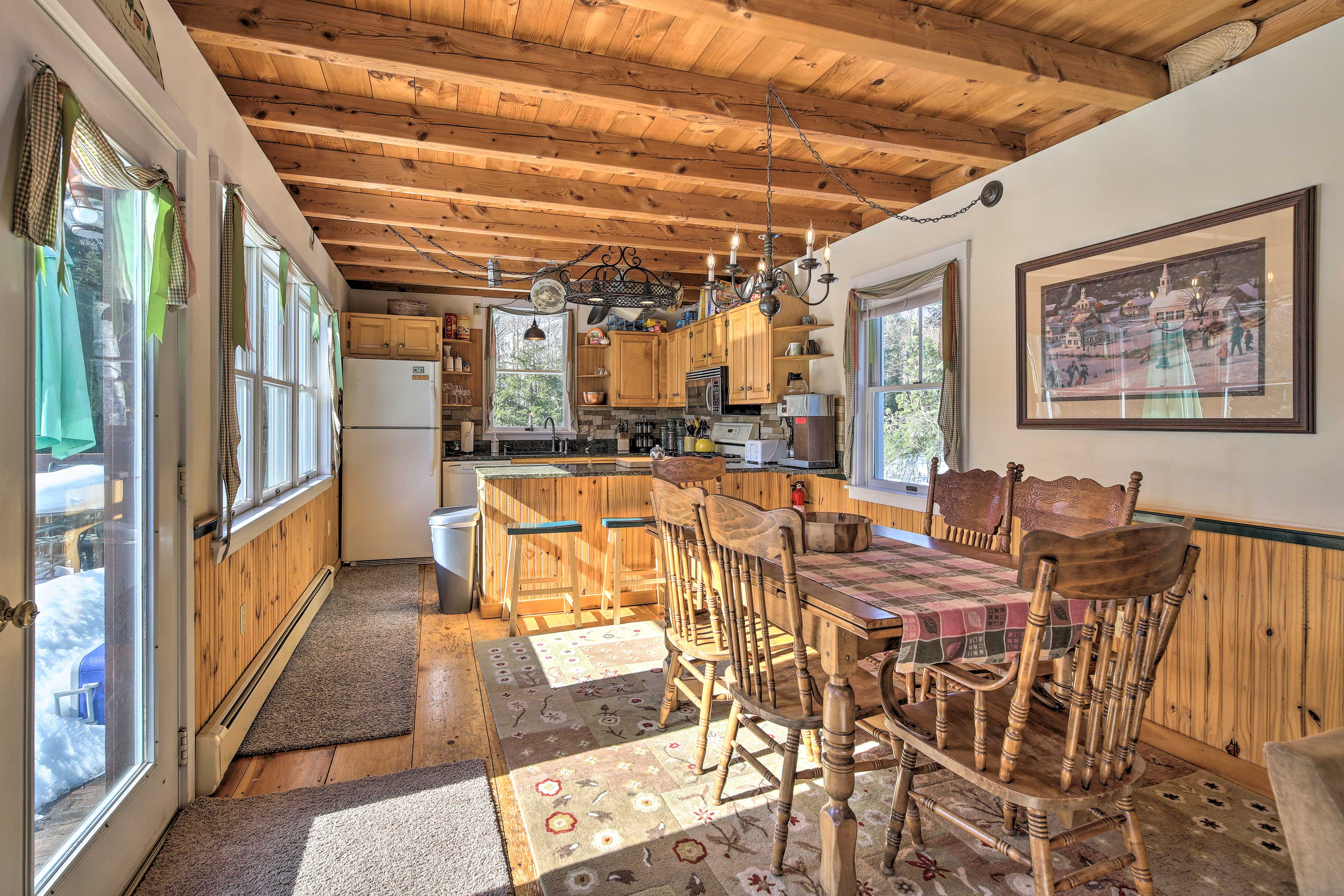 The open living space boasts hardwood floors and old-fashioned charm.