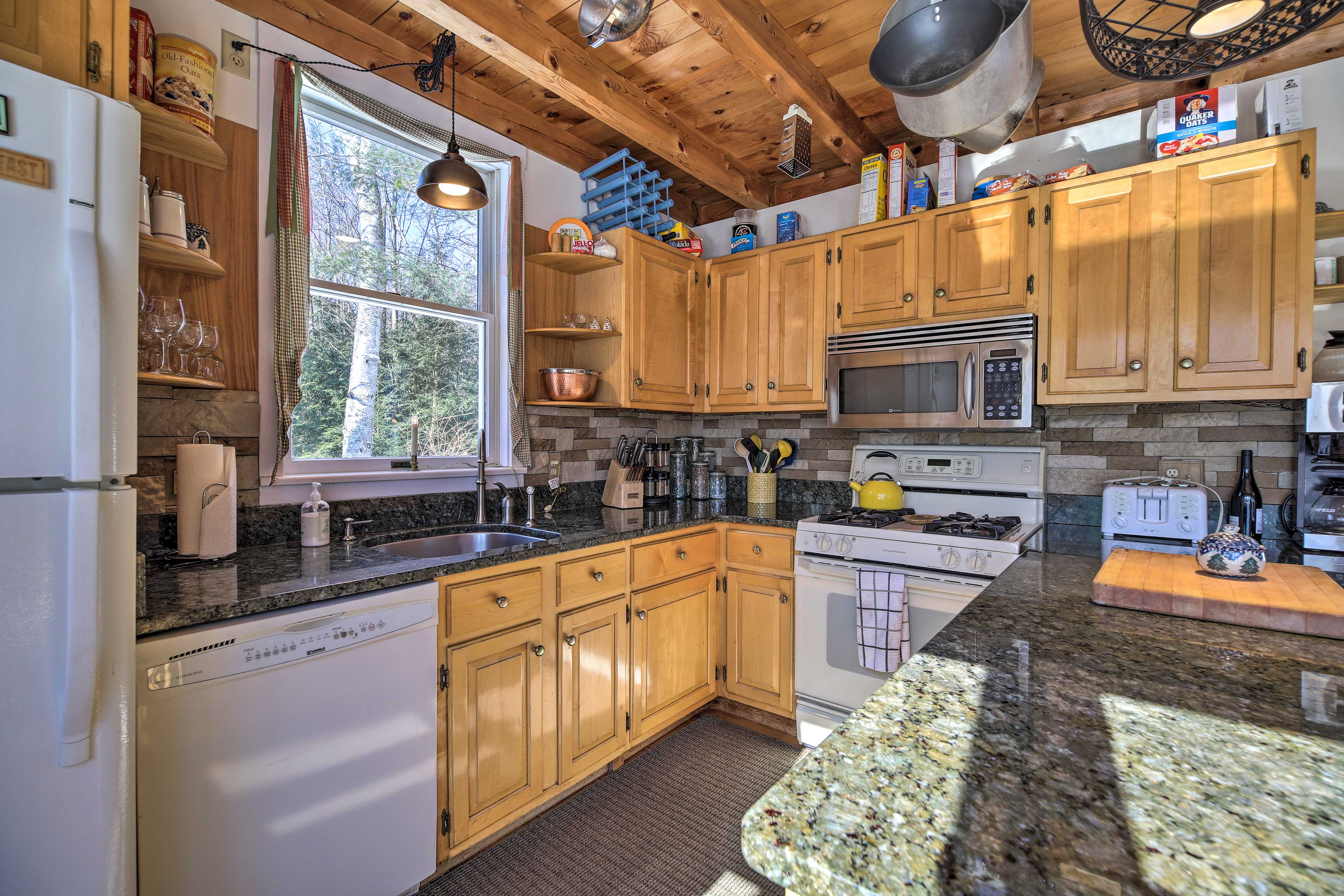 Spices, cookware and flatware complete the fully equipped kitchen.
