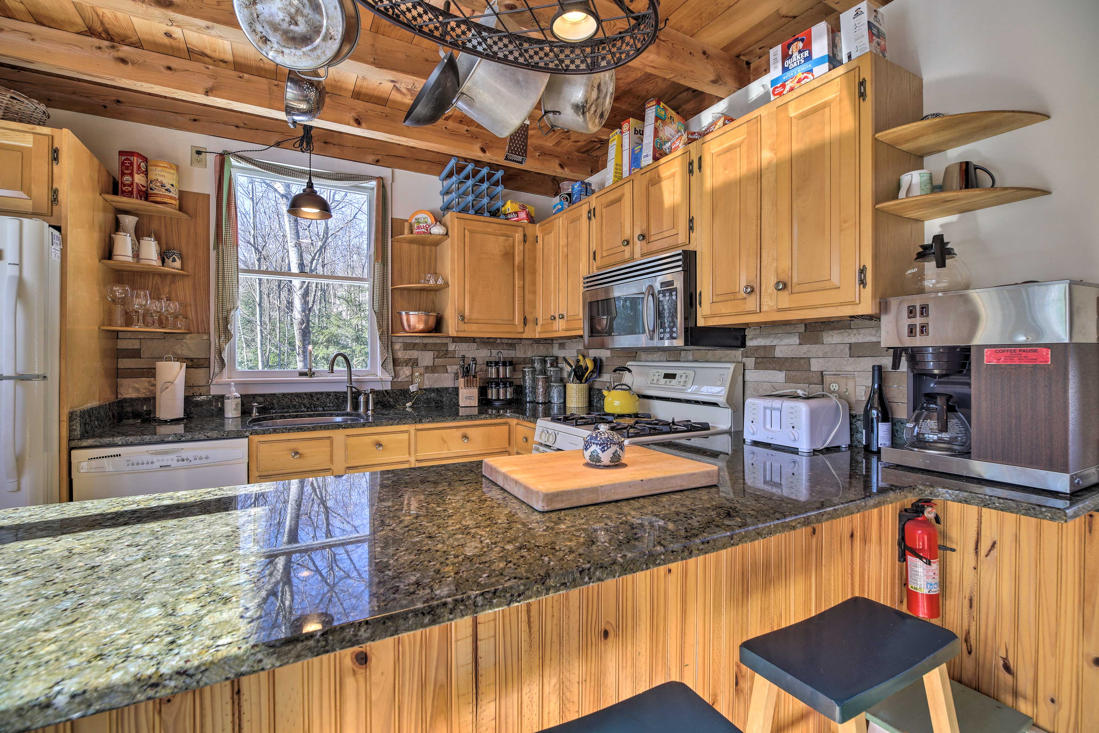 The kitchen boasts granite counters.