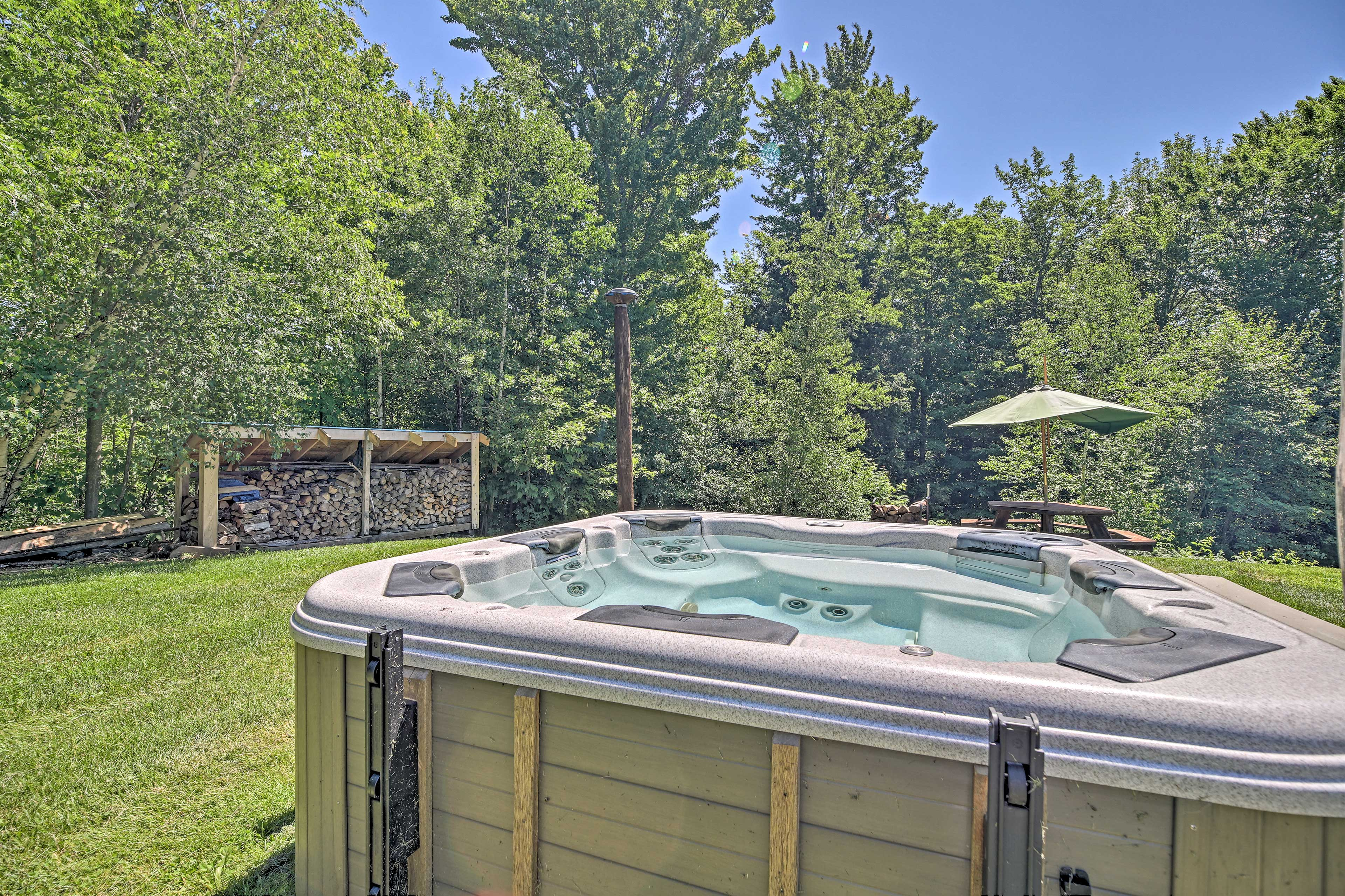 Use the hot tub and fire pit as you revel in your beautiful setting!