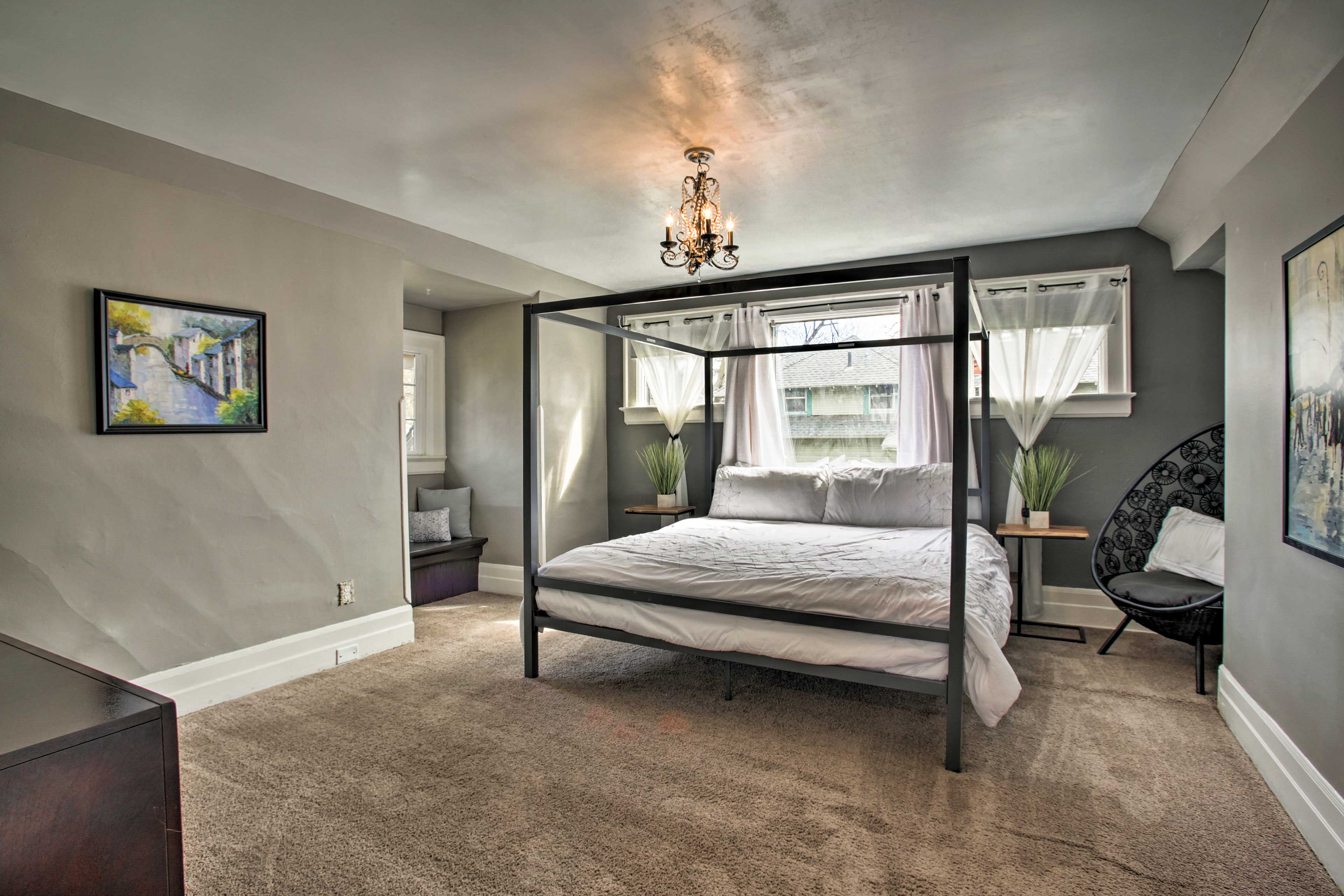 The master bedroom boasts a queen-sized bed.