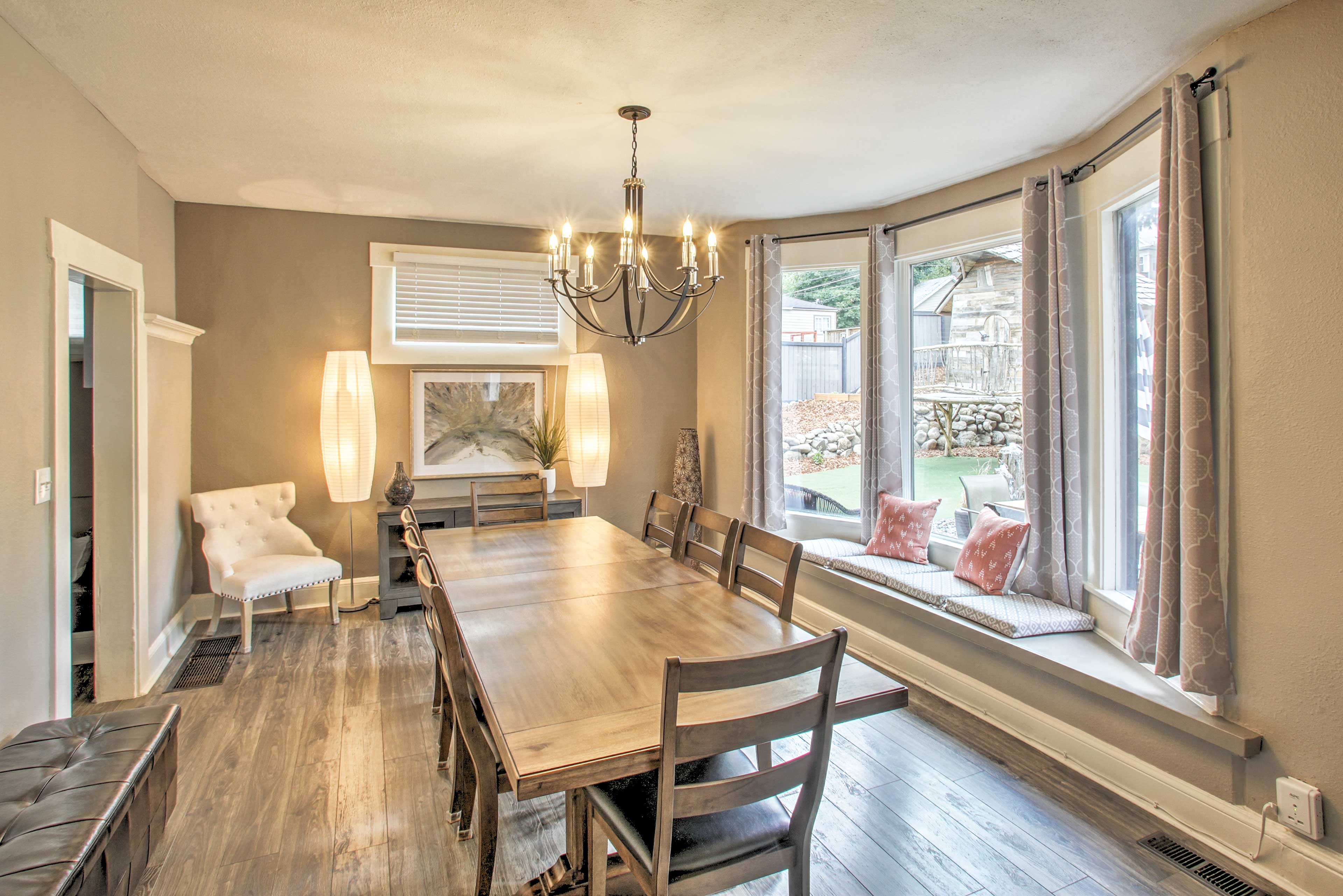 The pristine dining room features a table for 8!