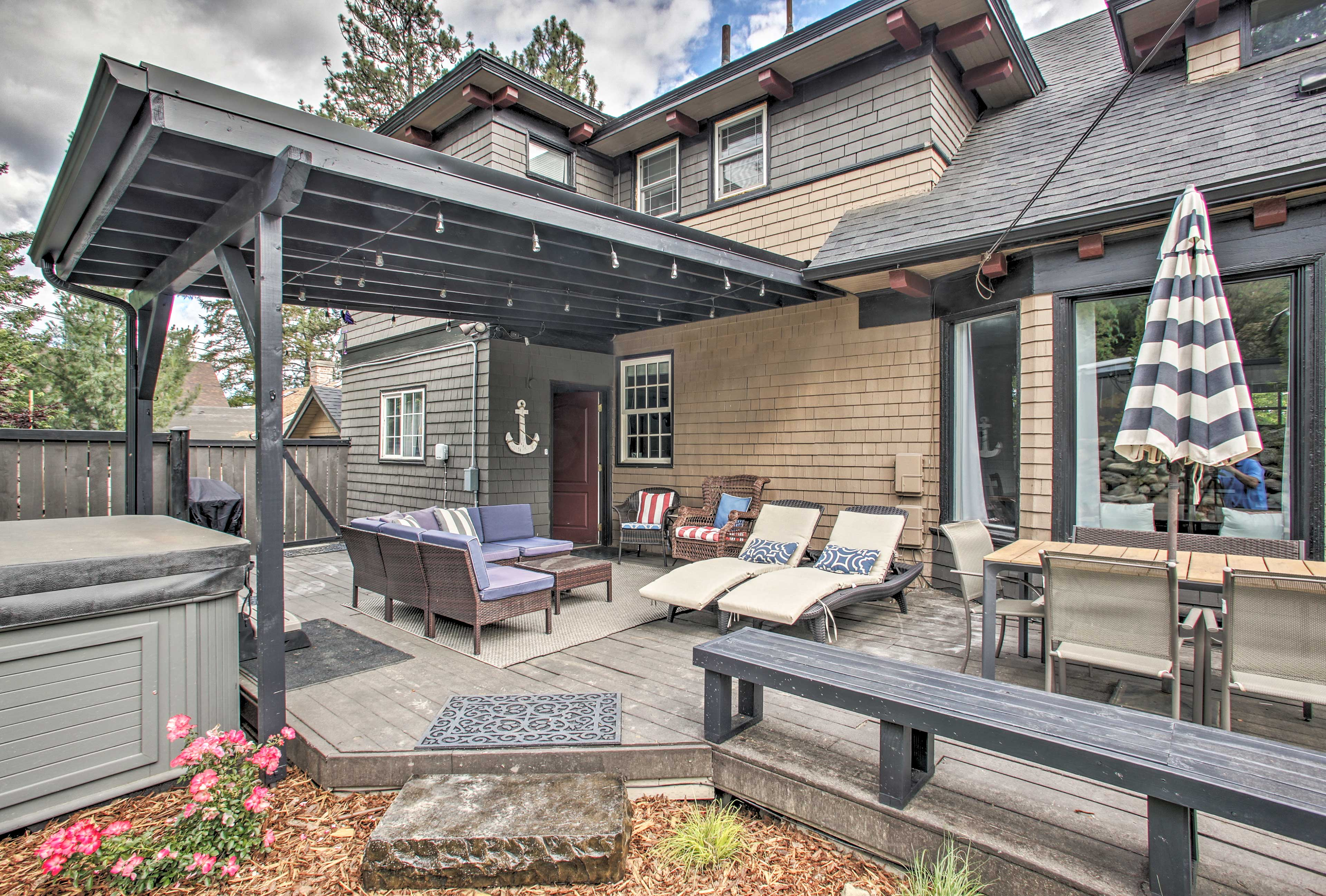 The furnished patio features a dining table, sectional, and plenty of seating.