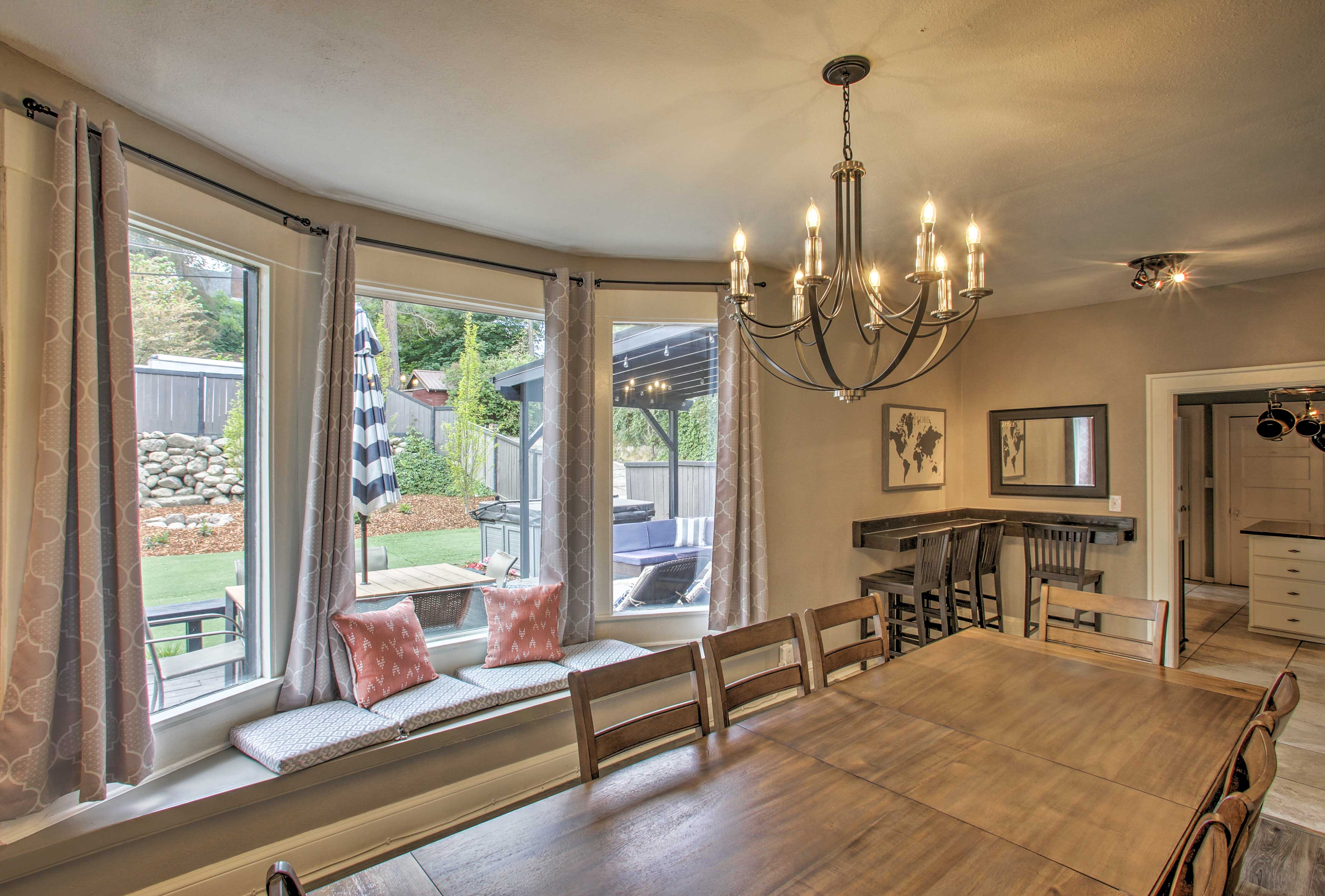 Large bay windows flood the room with natural light.