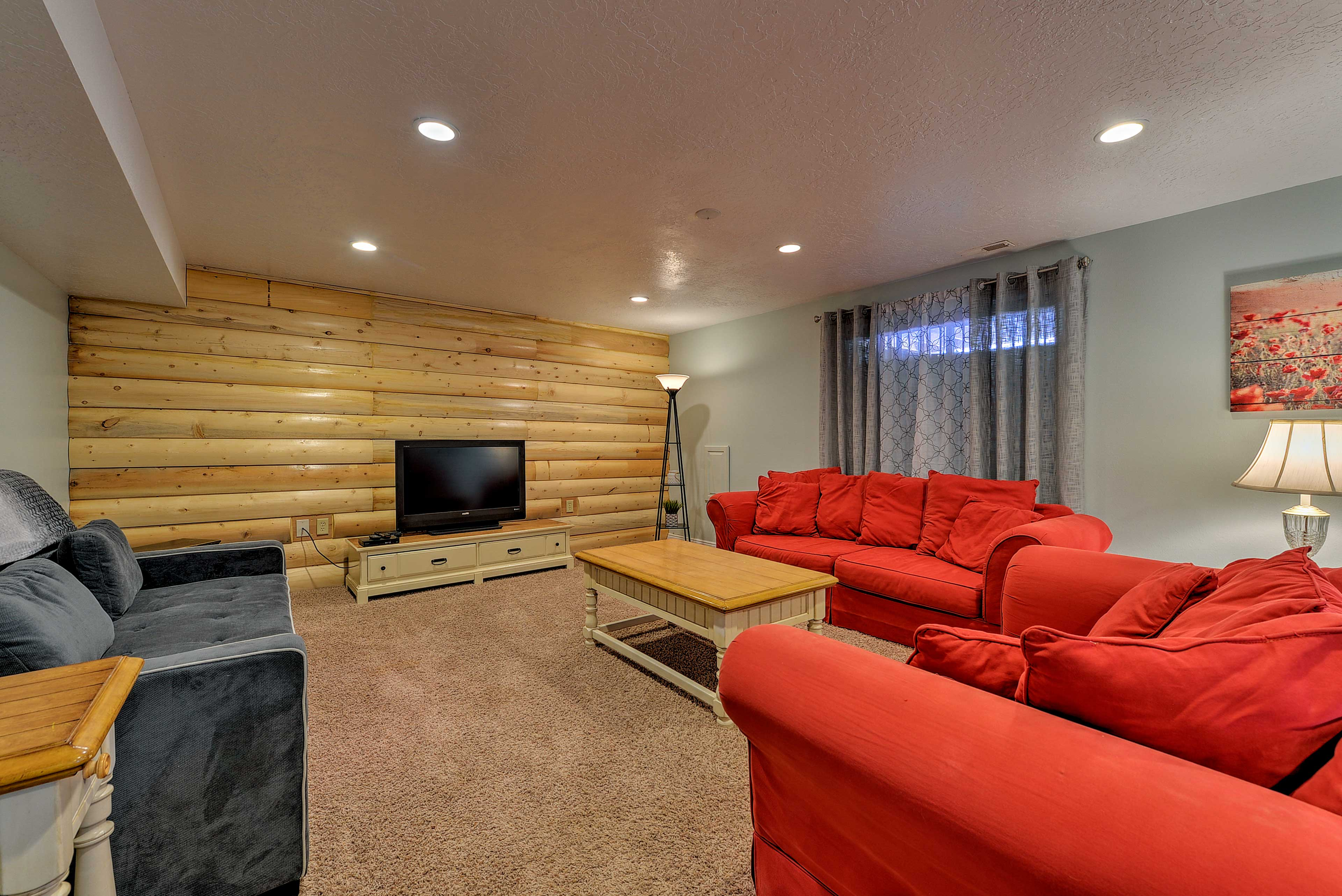 The exposed wood log wall is a beautiful touch.
