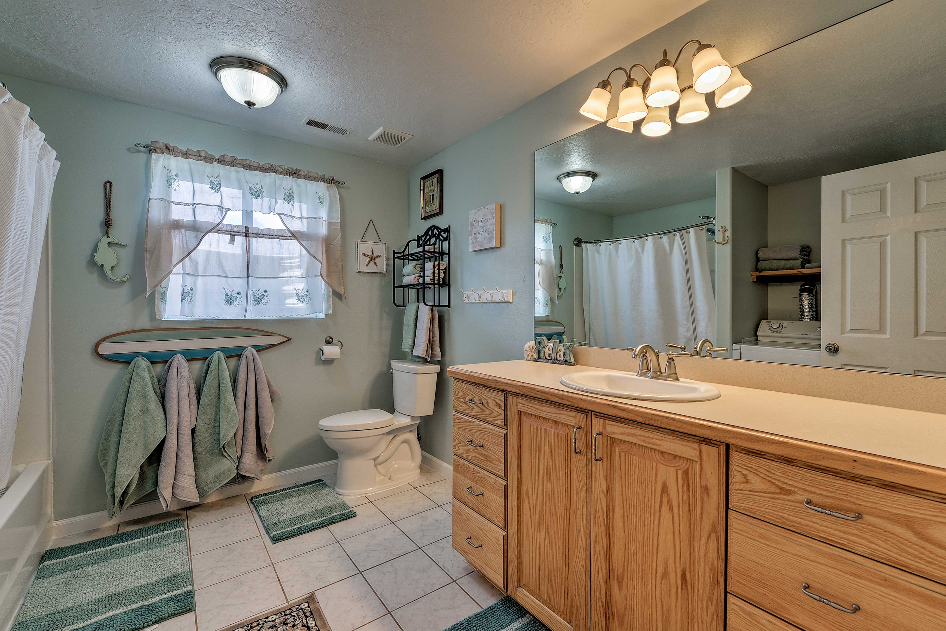 Wash away the day in the full bathroom.