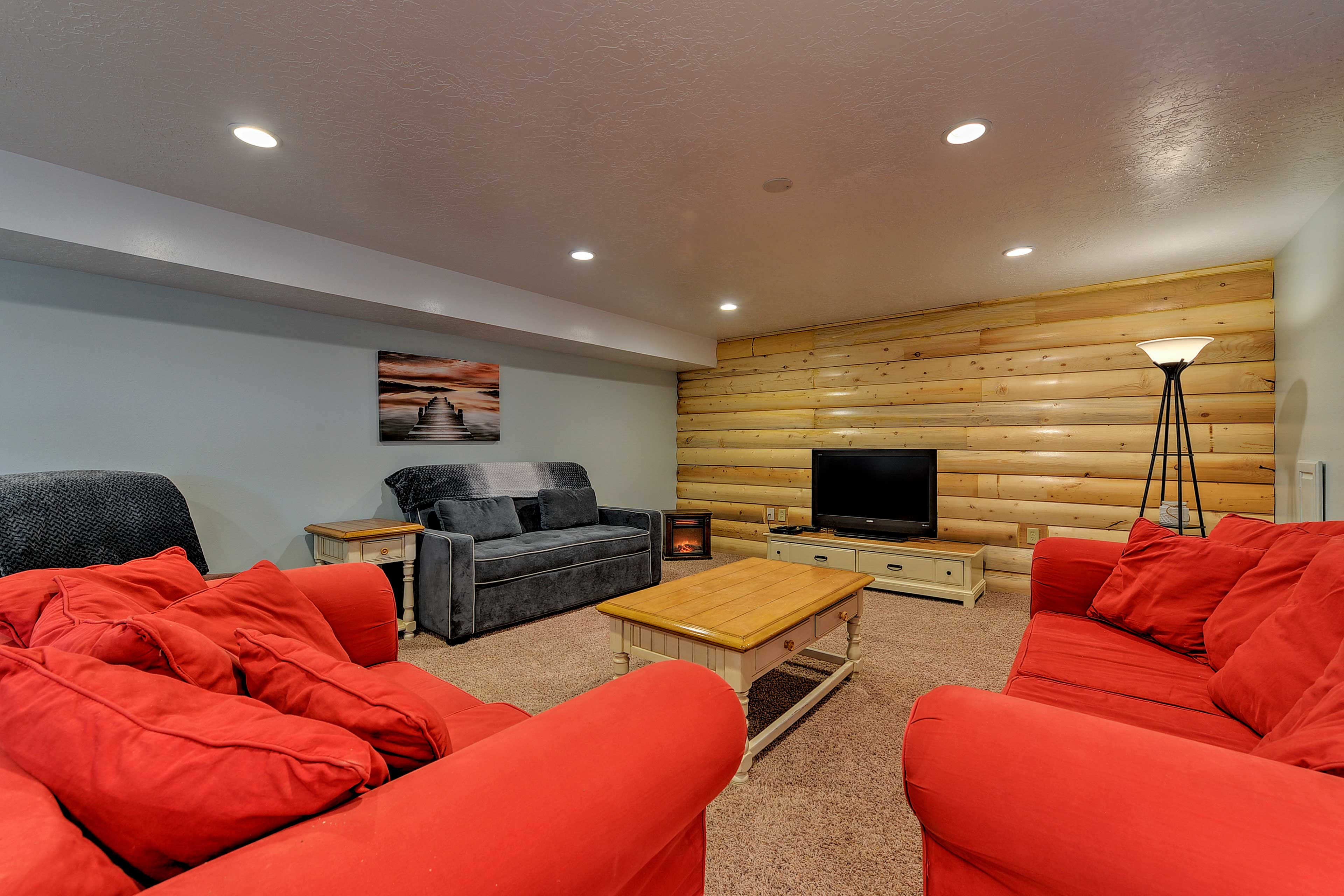 Sink into one of the 3 sofas and watch the flat-screen cable TV by the fireplace