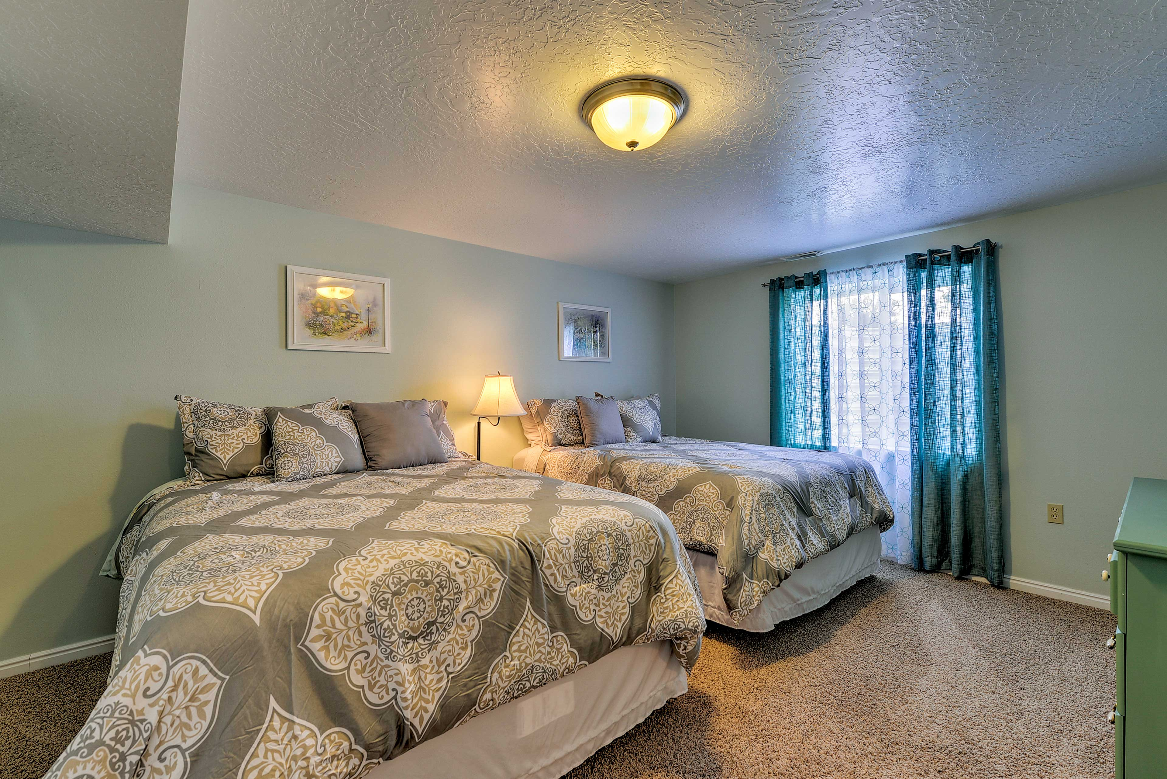 The first bedroom has 2 queen-sized beds.
