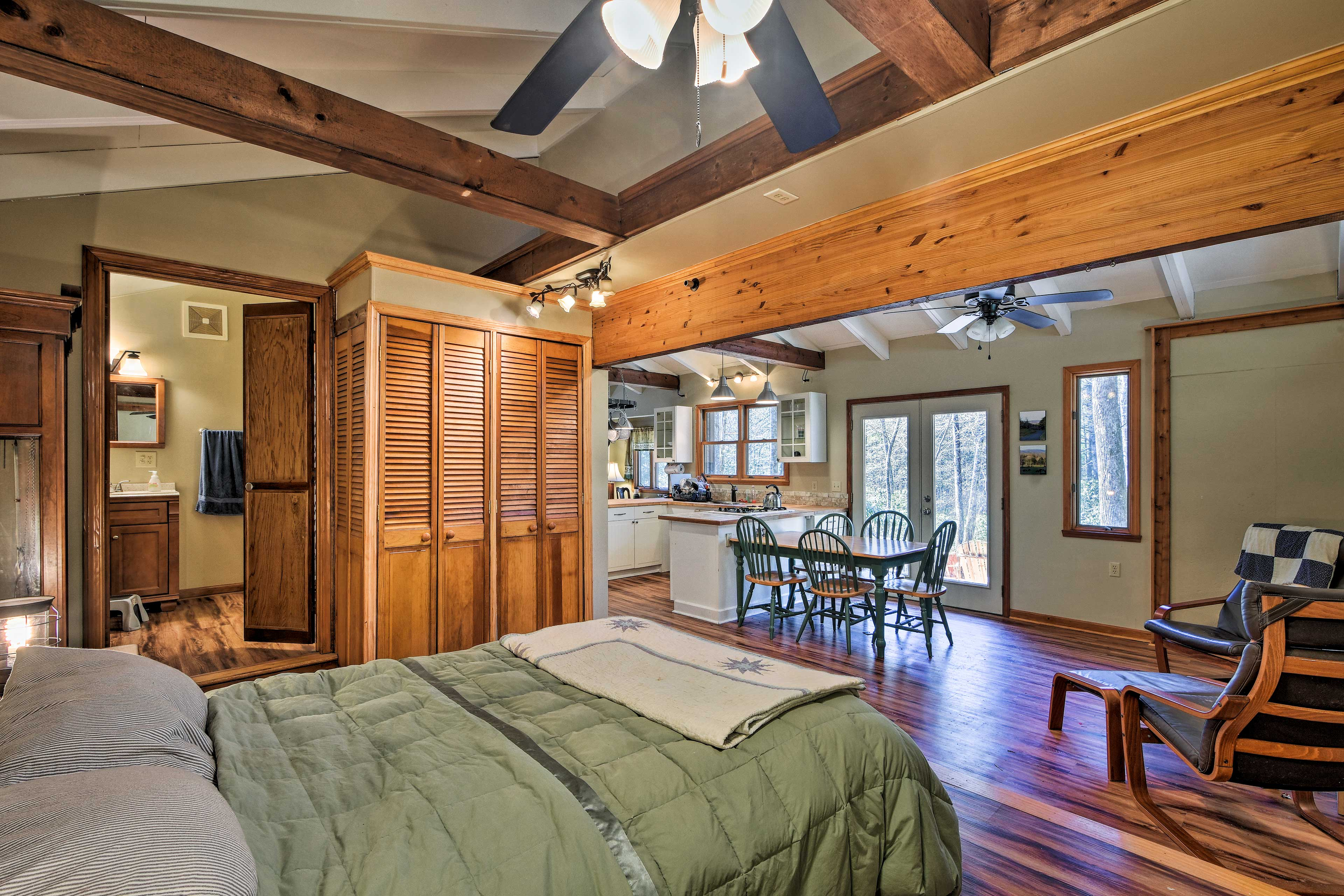 The king-sized bed awaits in it's own alcove off the main space.