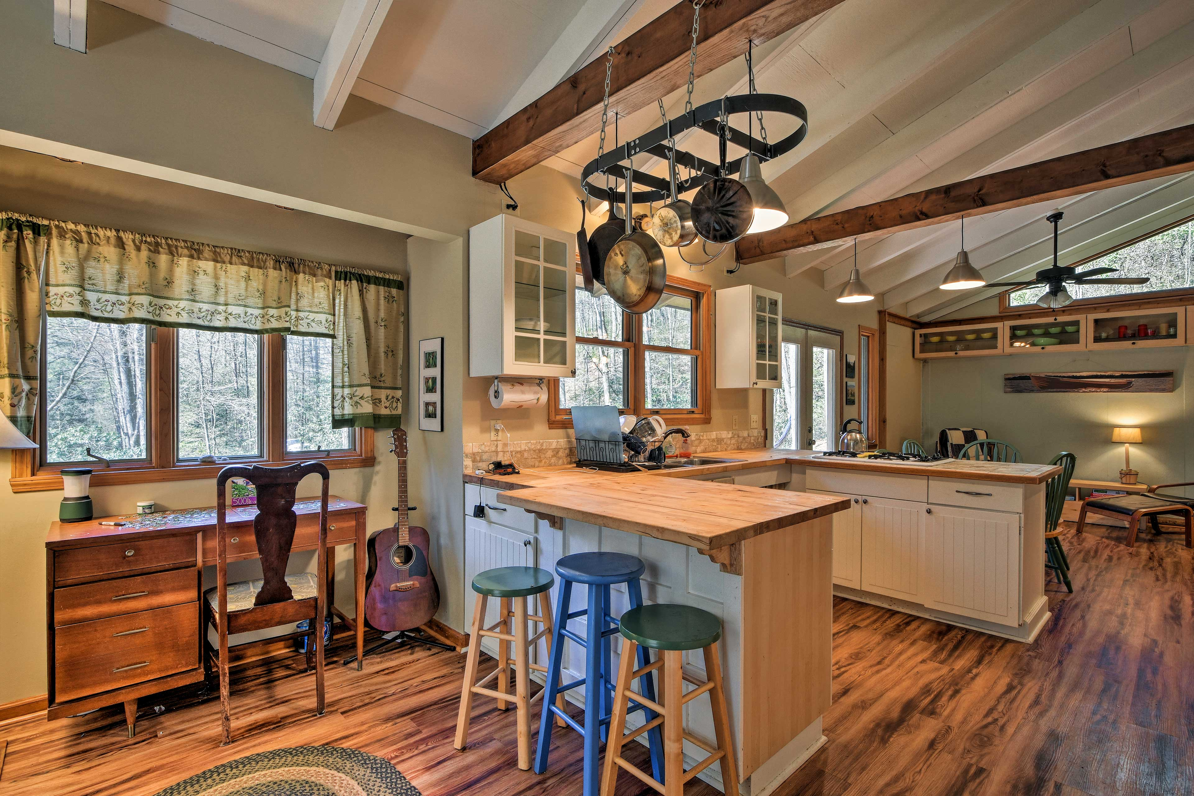 The home features free WiFi, a desk, acoustic guitar, & high-top breakfast bar.