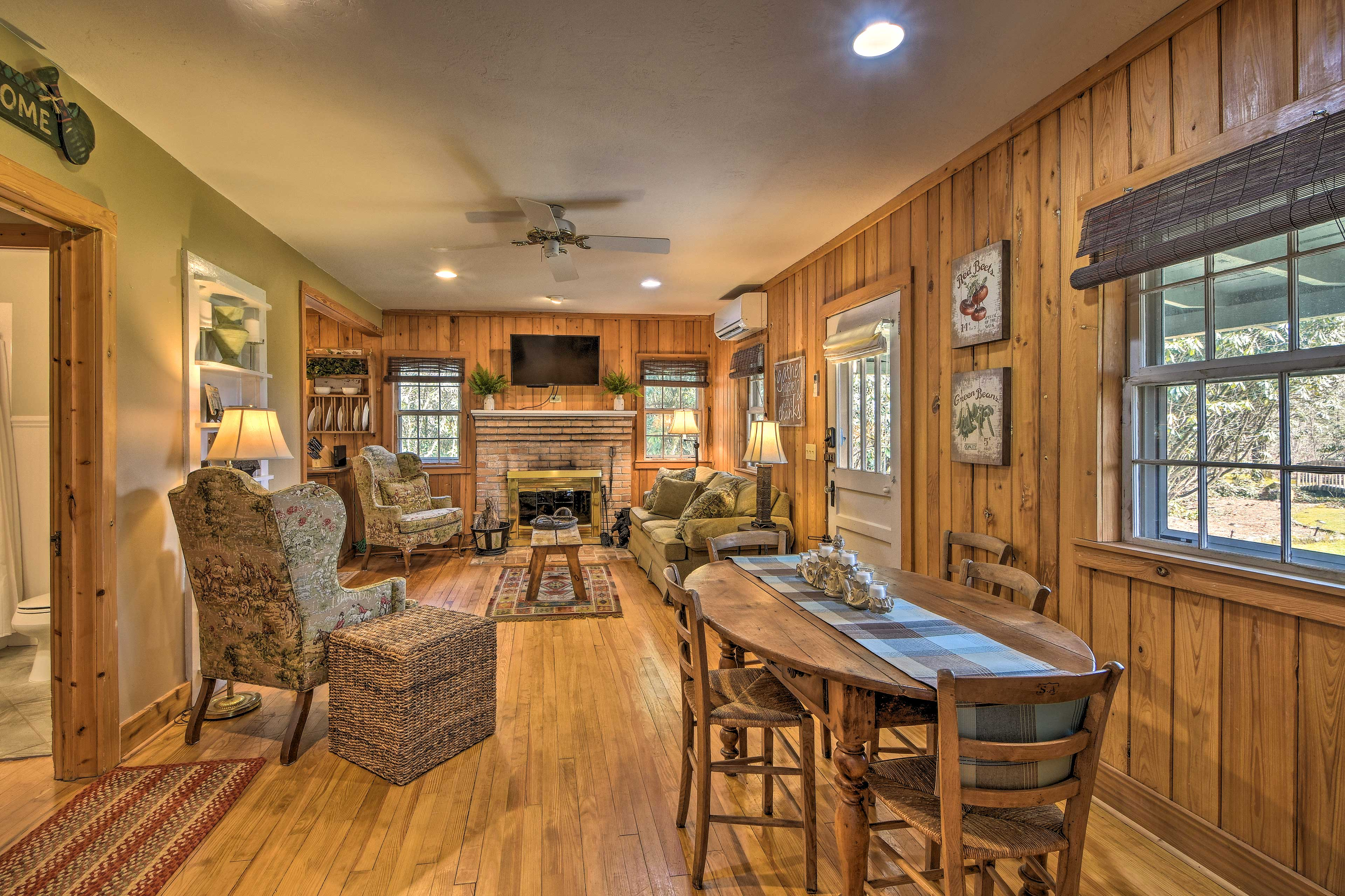 Rustic wood walls welcome you inside the cottage.