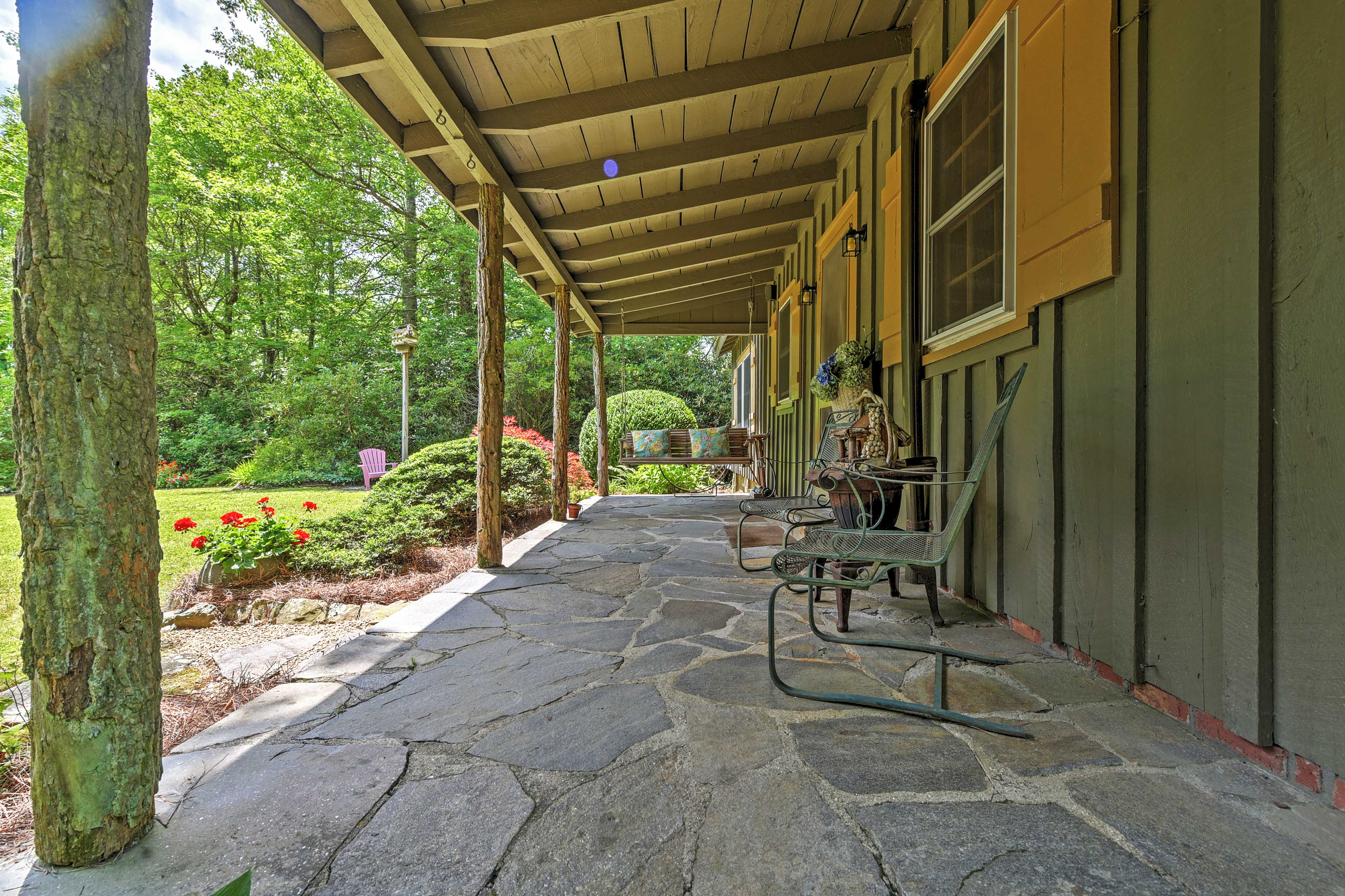 Look out at the lush landscaping that surrounds the home.