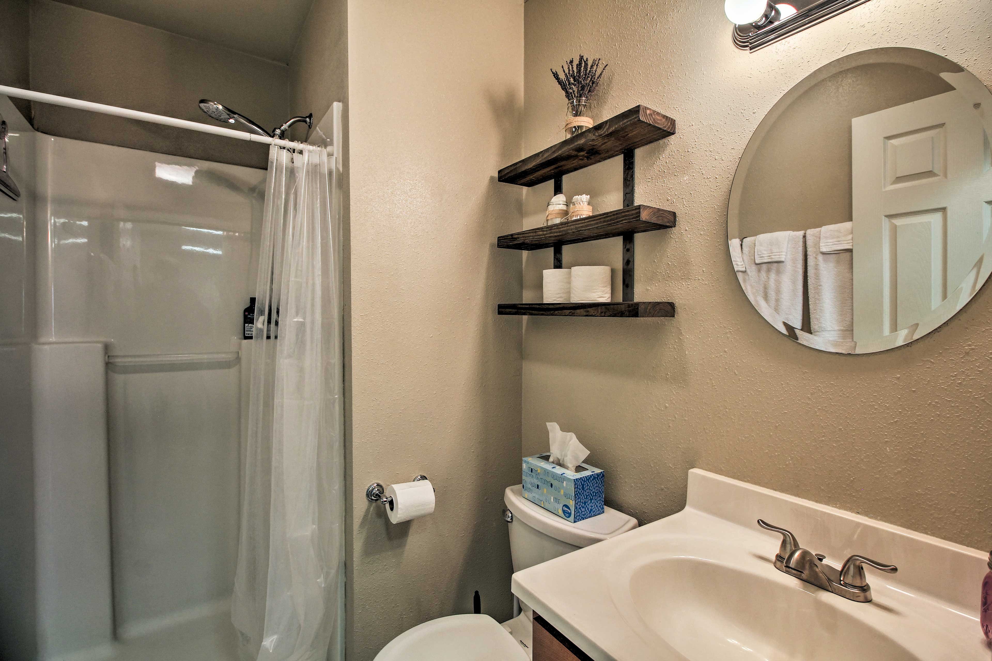 The full bathroom includes a walk-in shower.