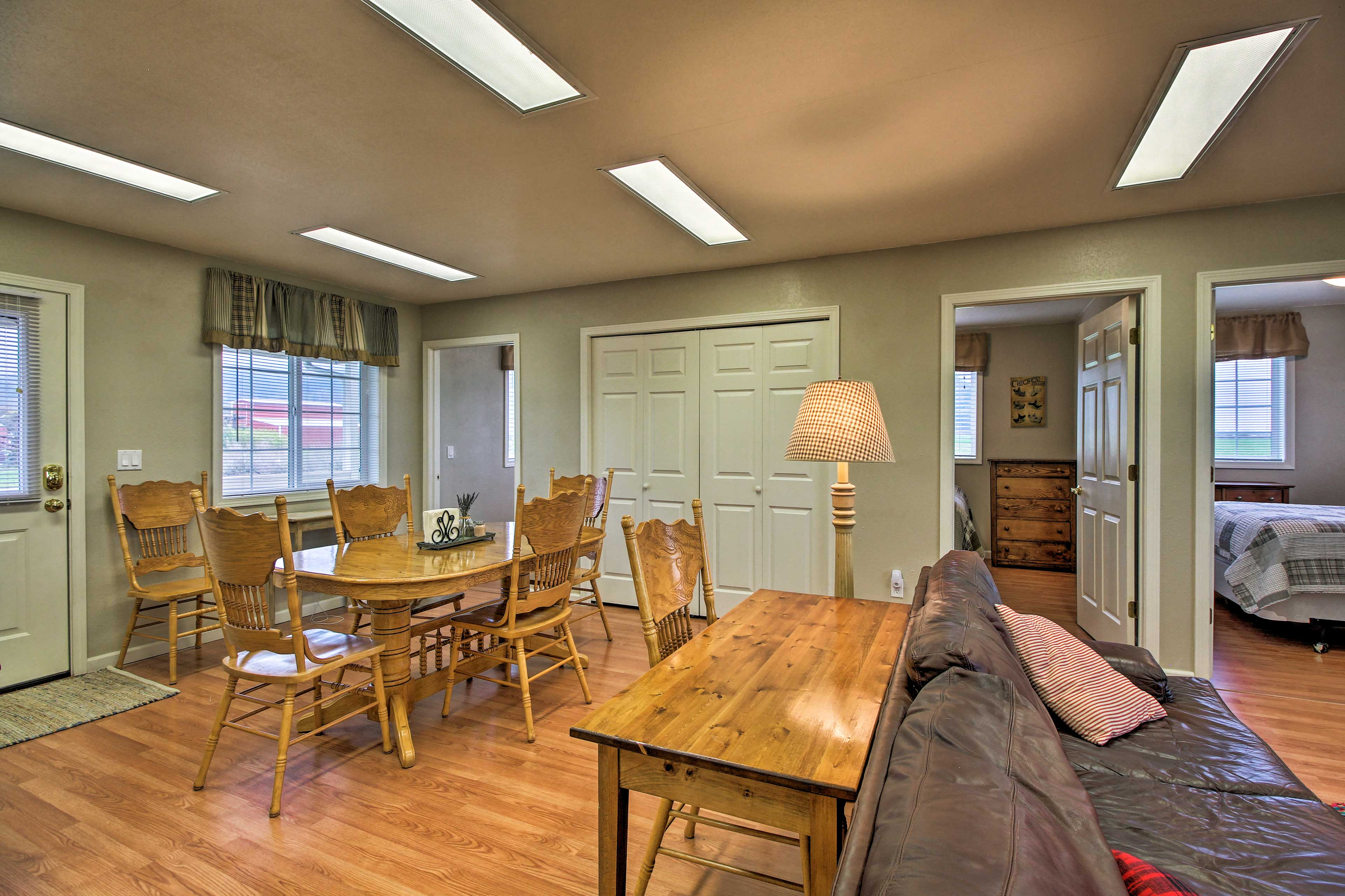 The 5-person dining table is adjacent to the living room.