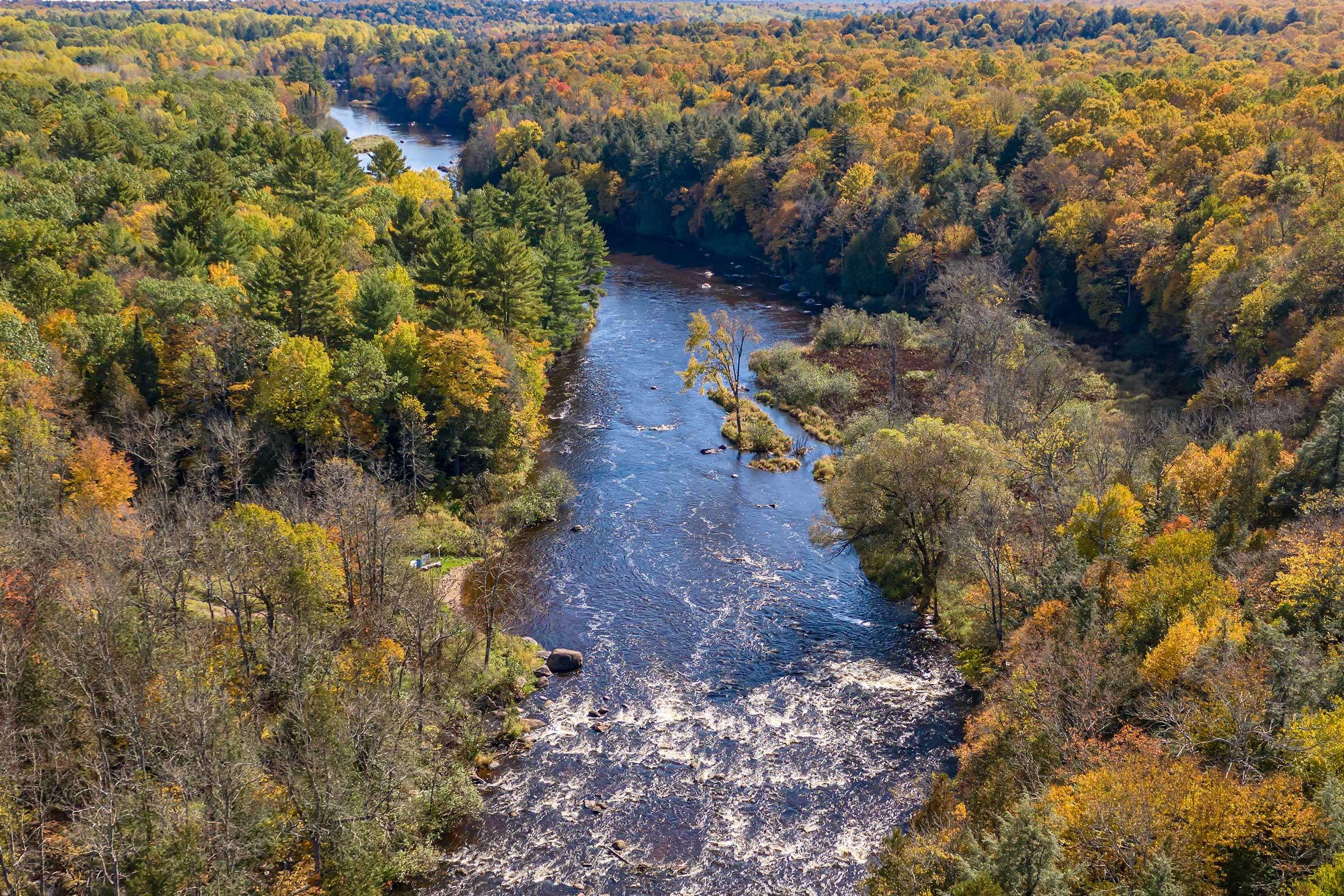 The Wolf River runs by just steps away from your front door.