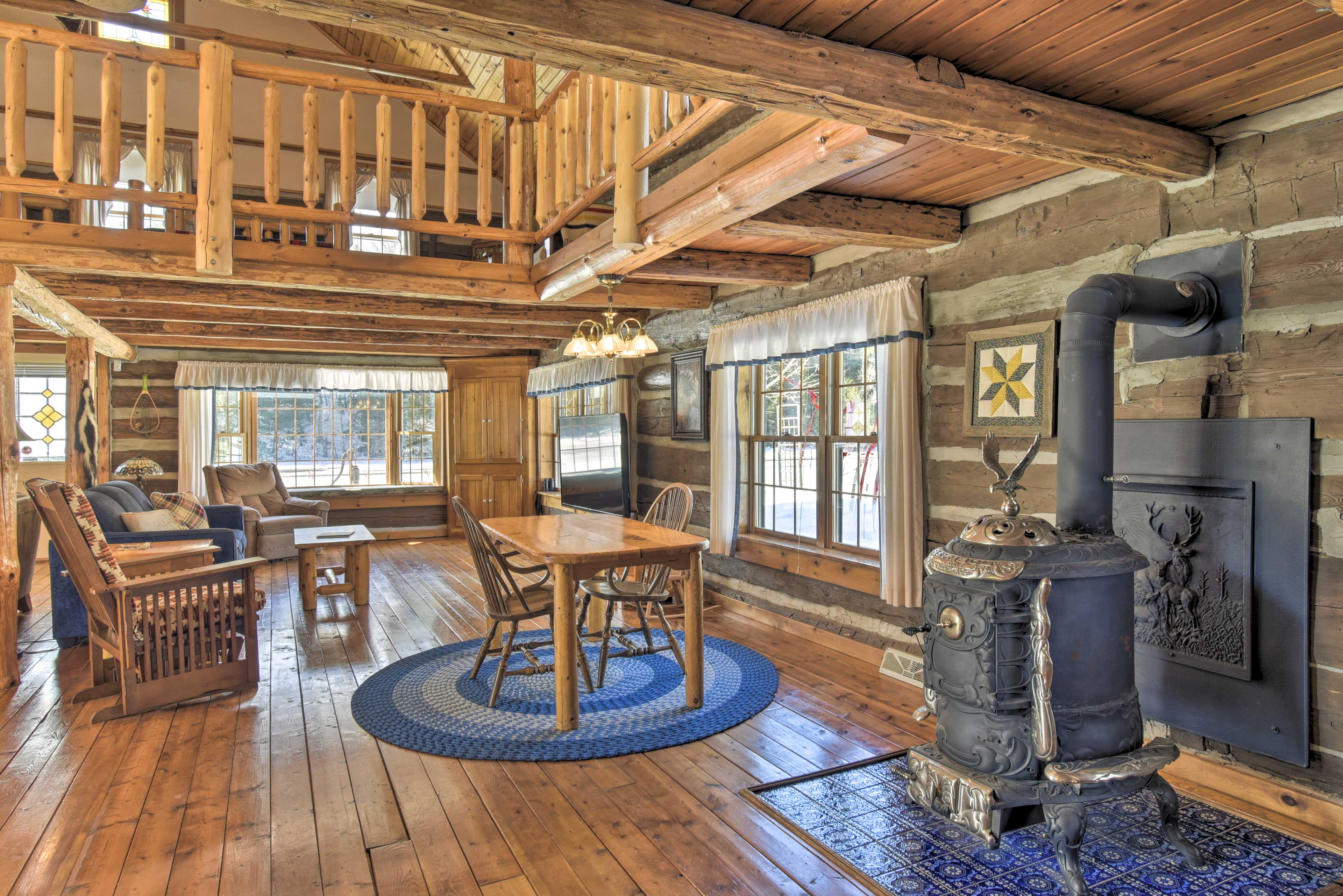 The living room features a decorative vintage wood-burning stove.