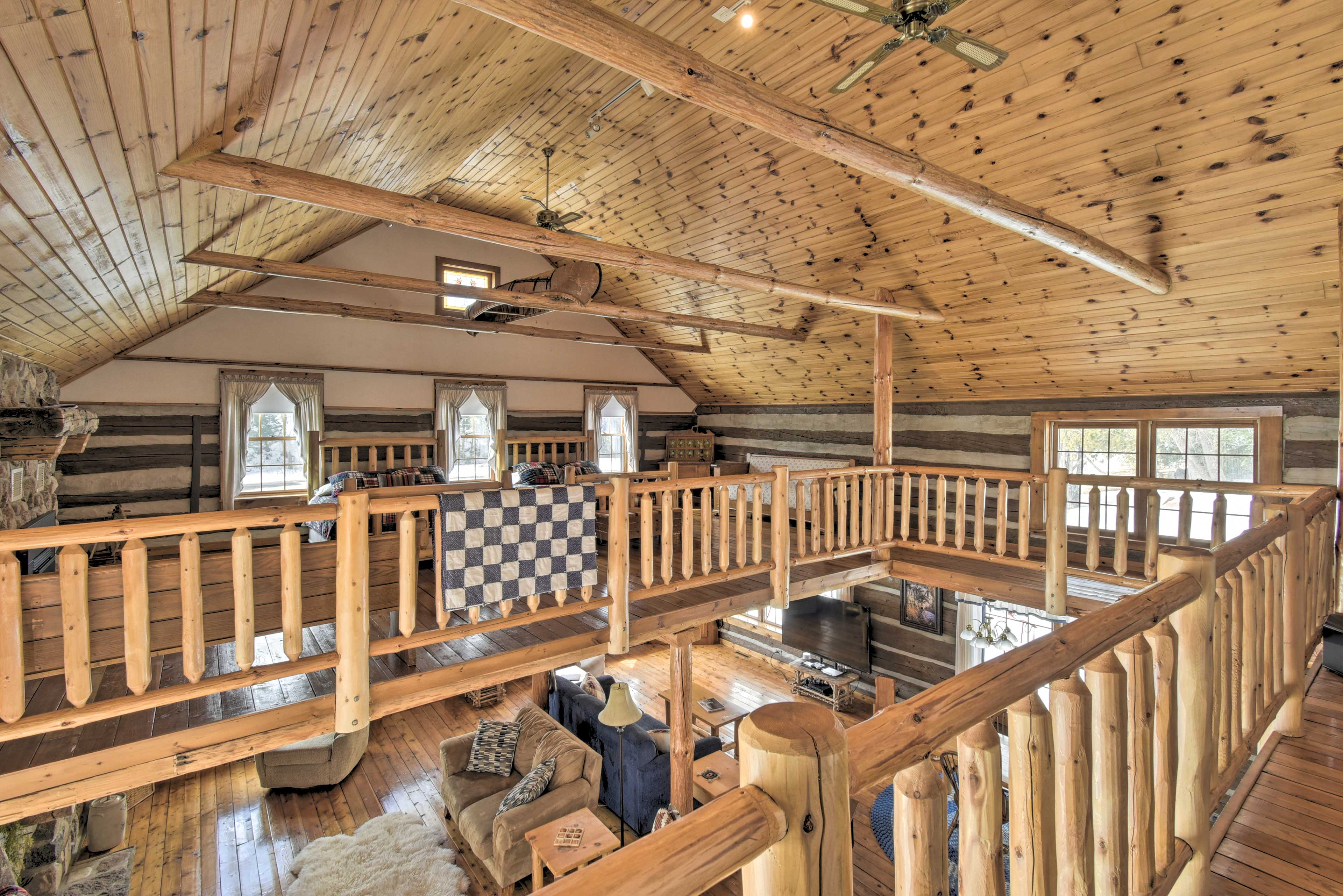 Look down below at the spacious cabin from the open loft!