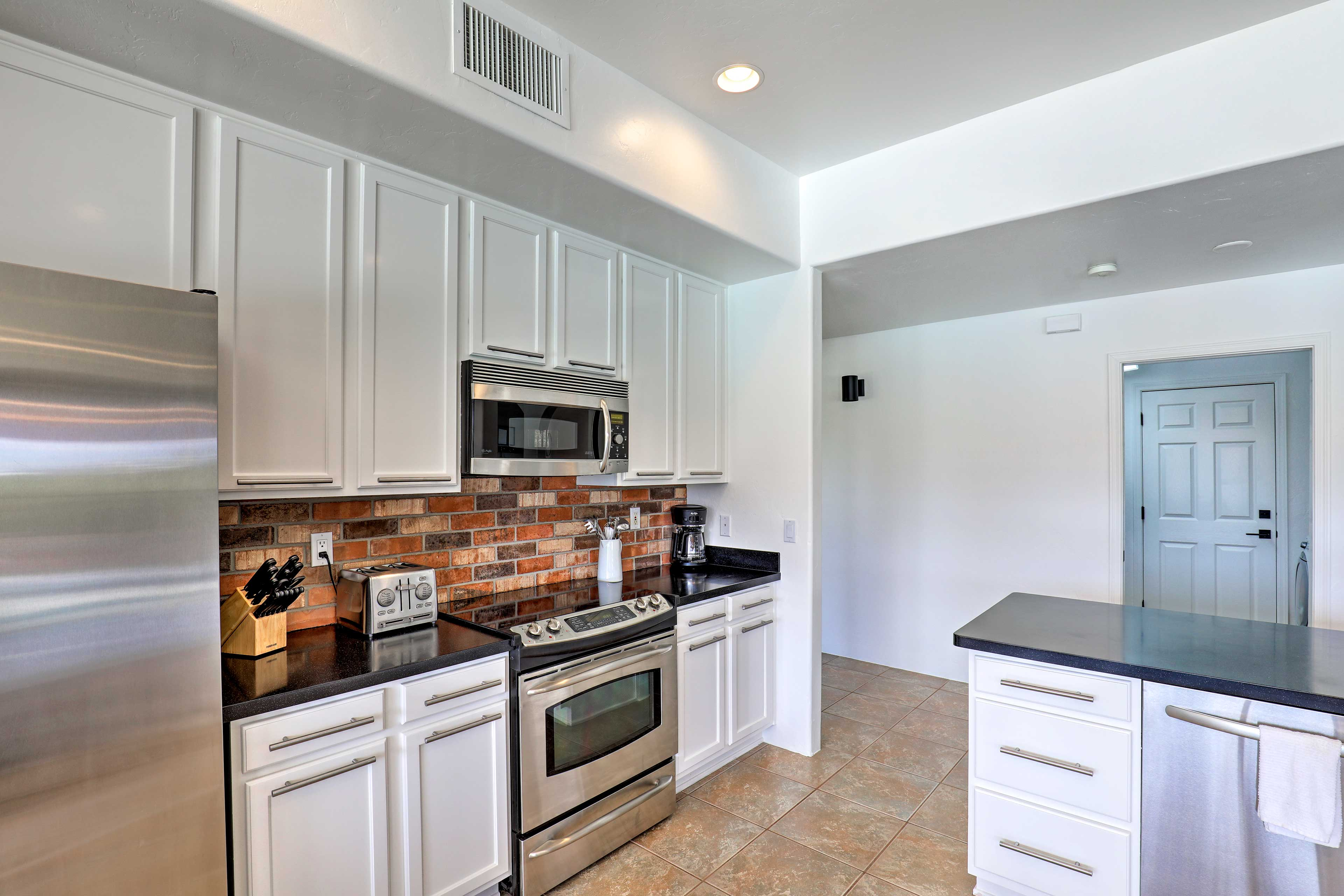 Utilize the stainless steel appliances in this beautiful kitchen.