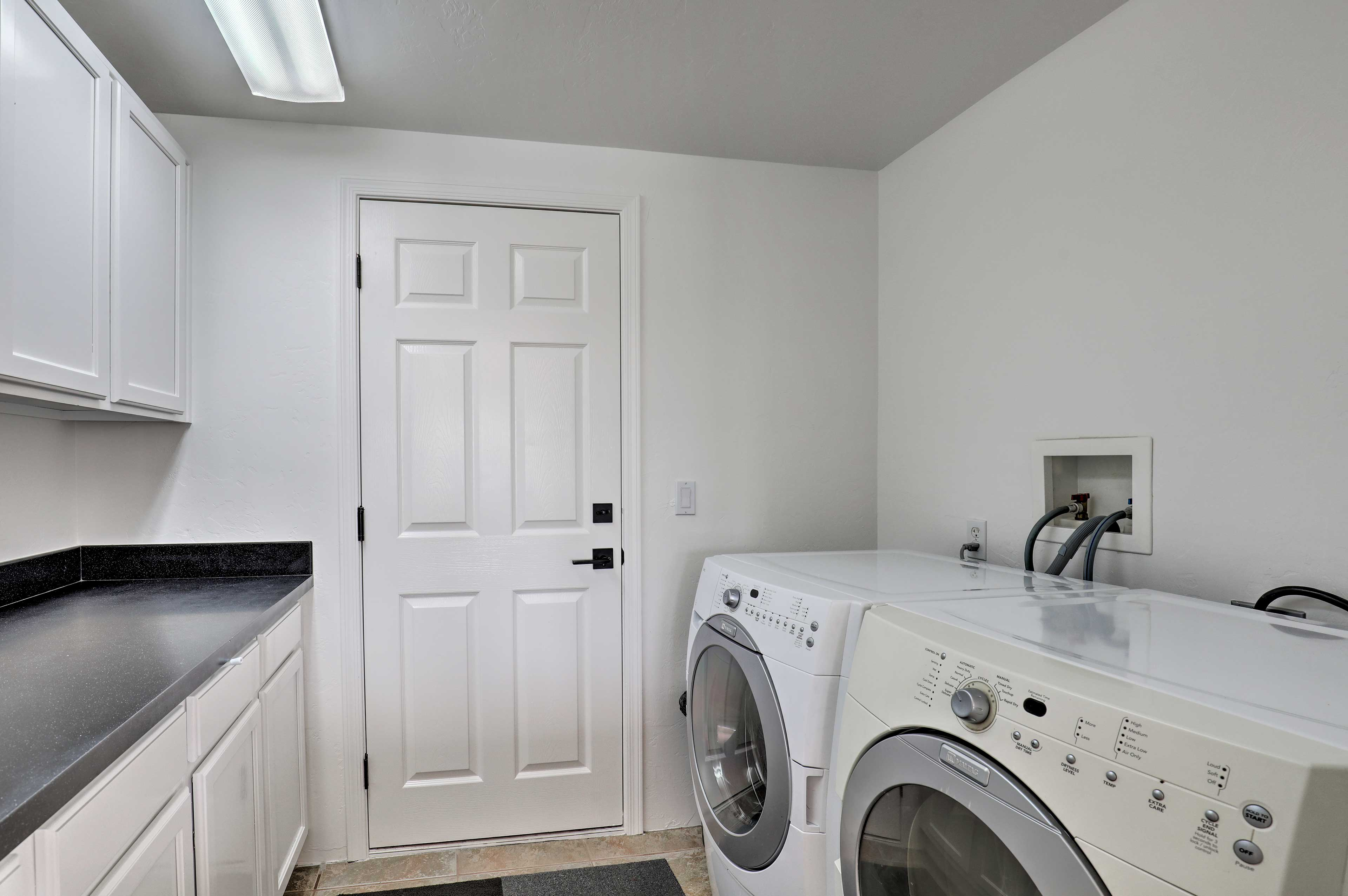 Don't overpack! Feel free to use this full laundry room just off the kitchen.