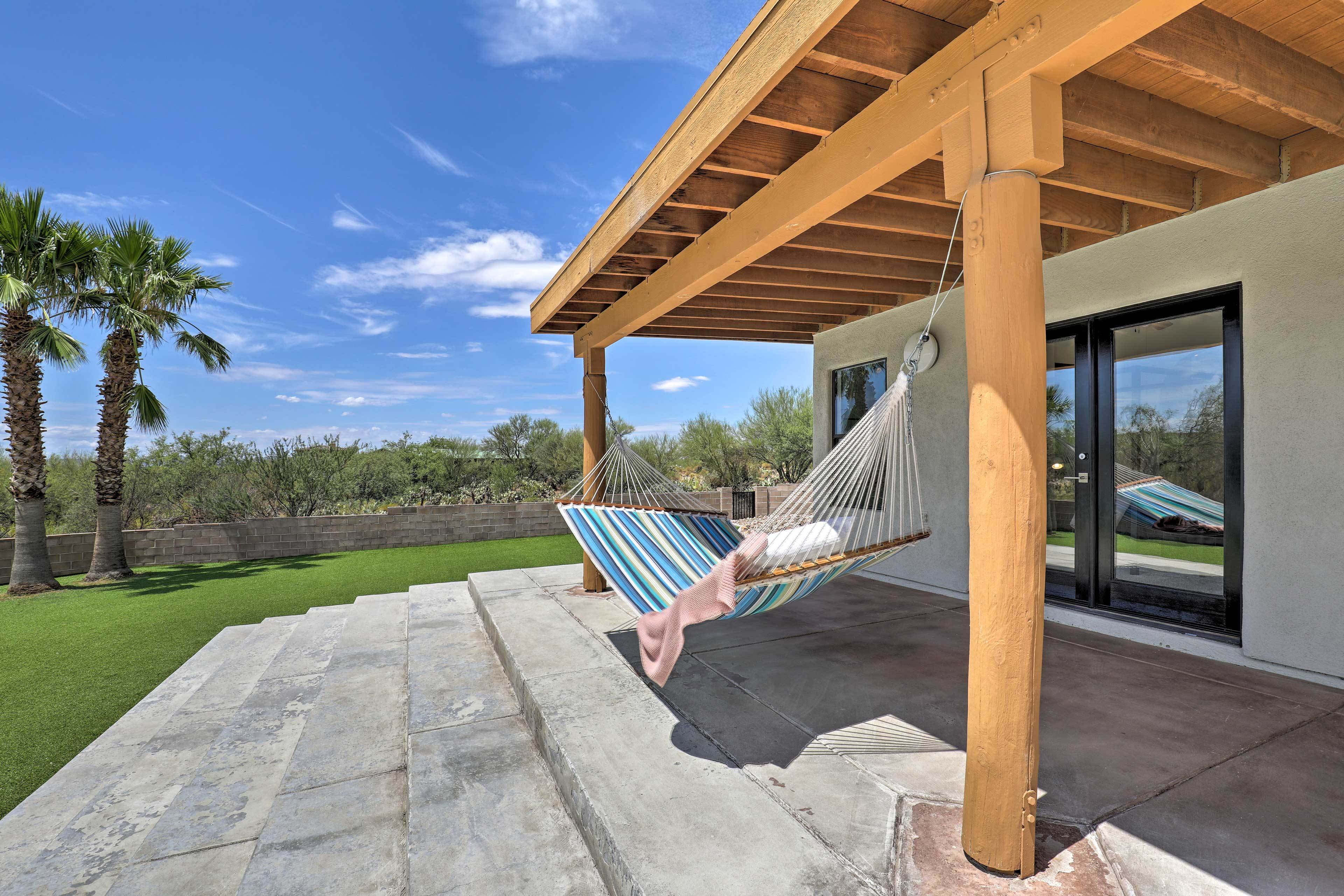 Relax after a day in the pool or lay in the hammock to get a tan.