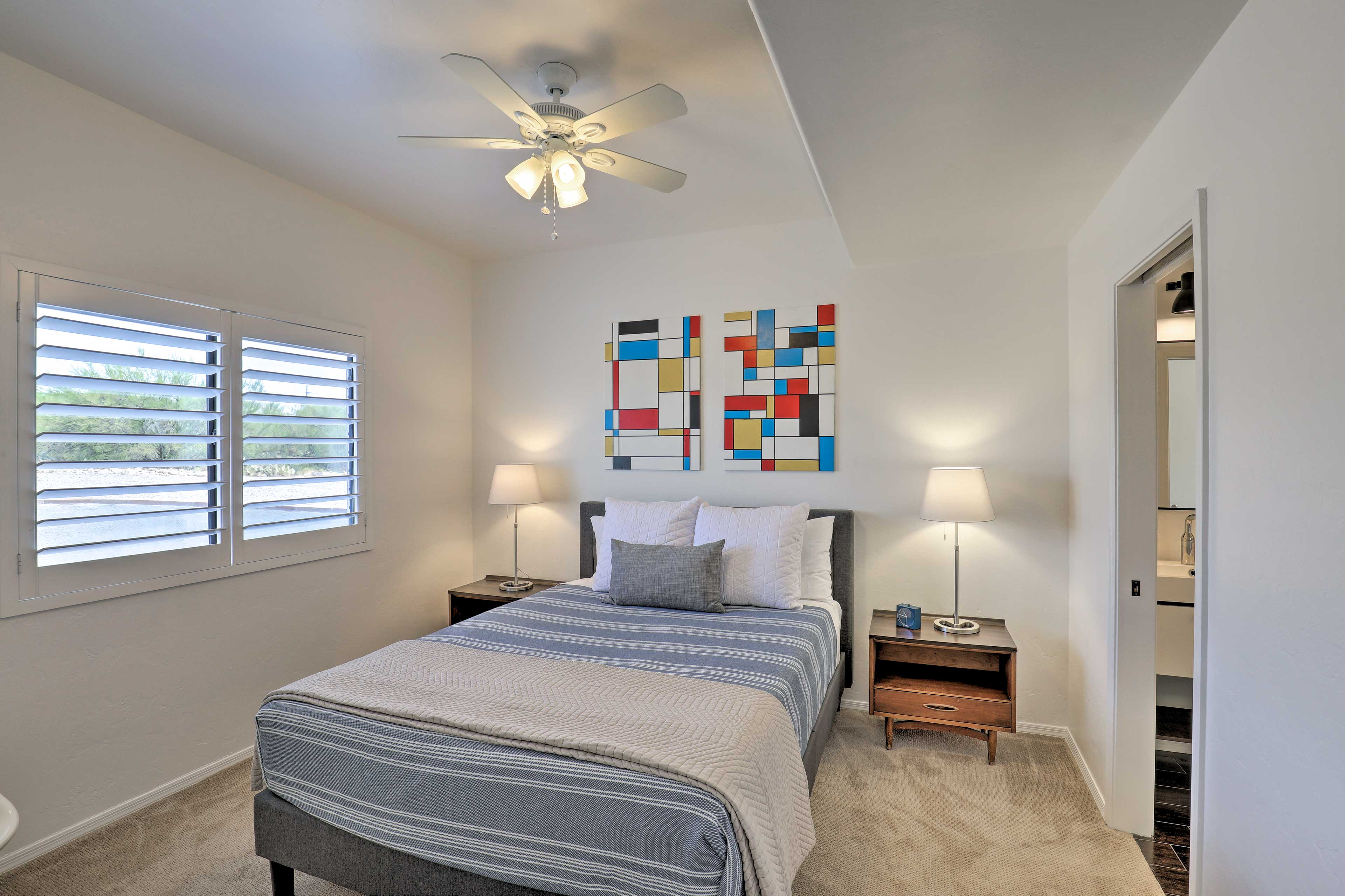 This bedroom with a queen bed also features an en-suite bathroom.