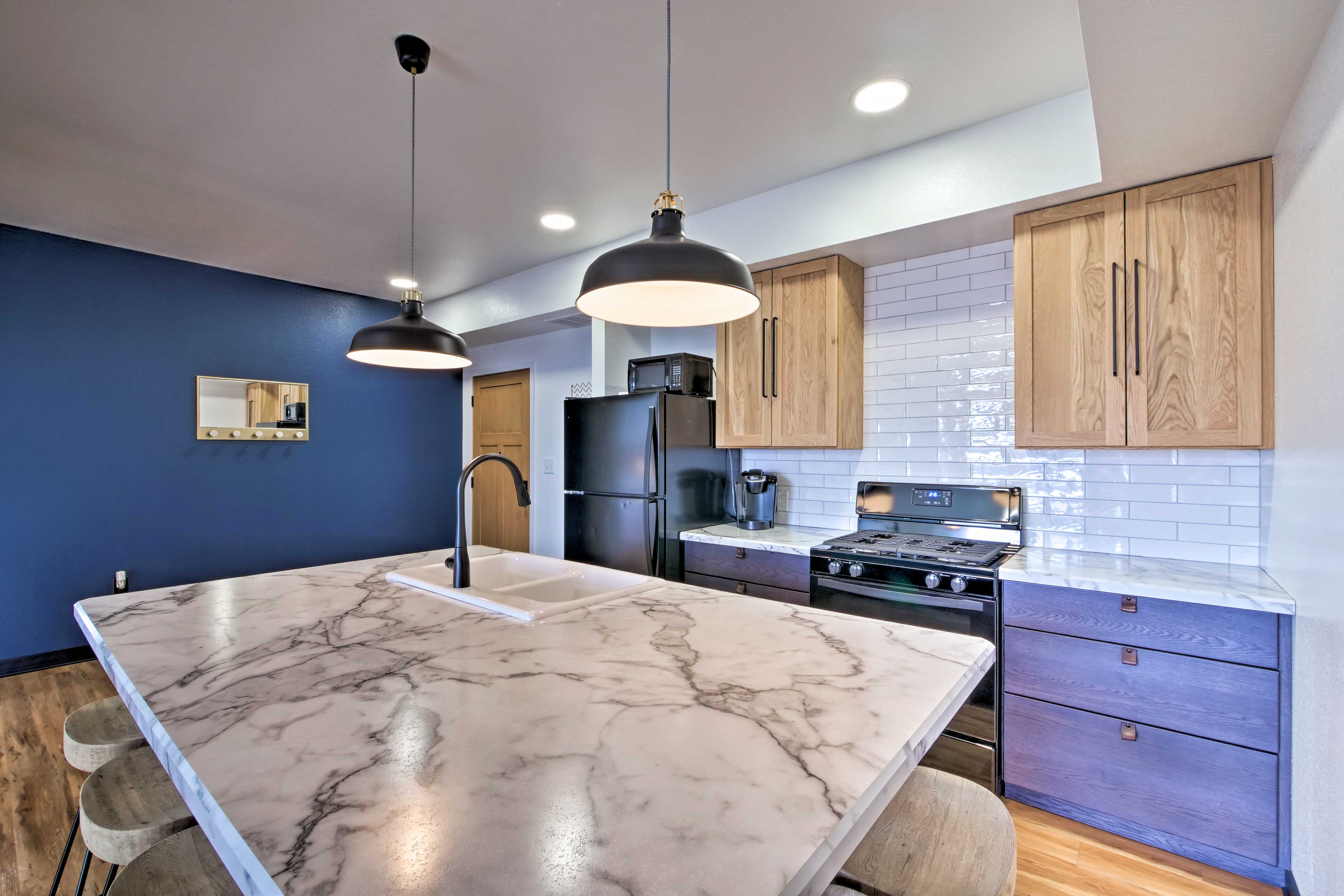 The well-equipped kitchen is complete with beautiful Formica countertops.