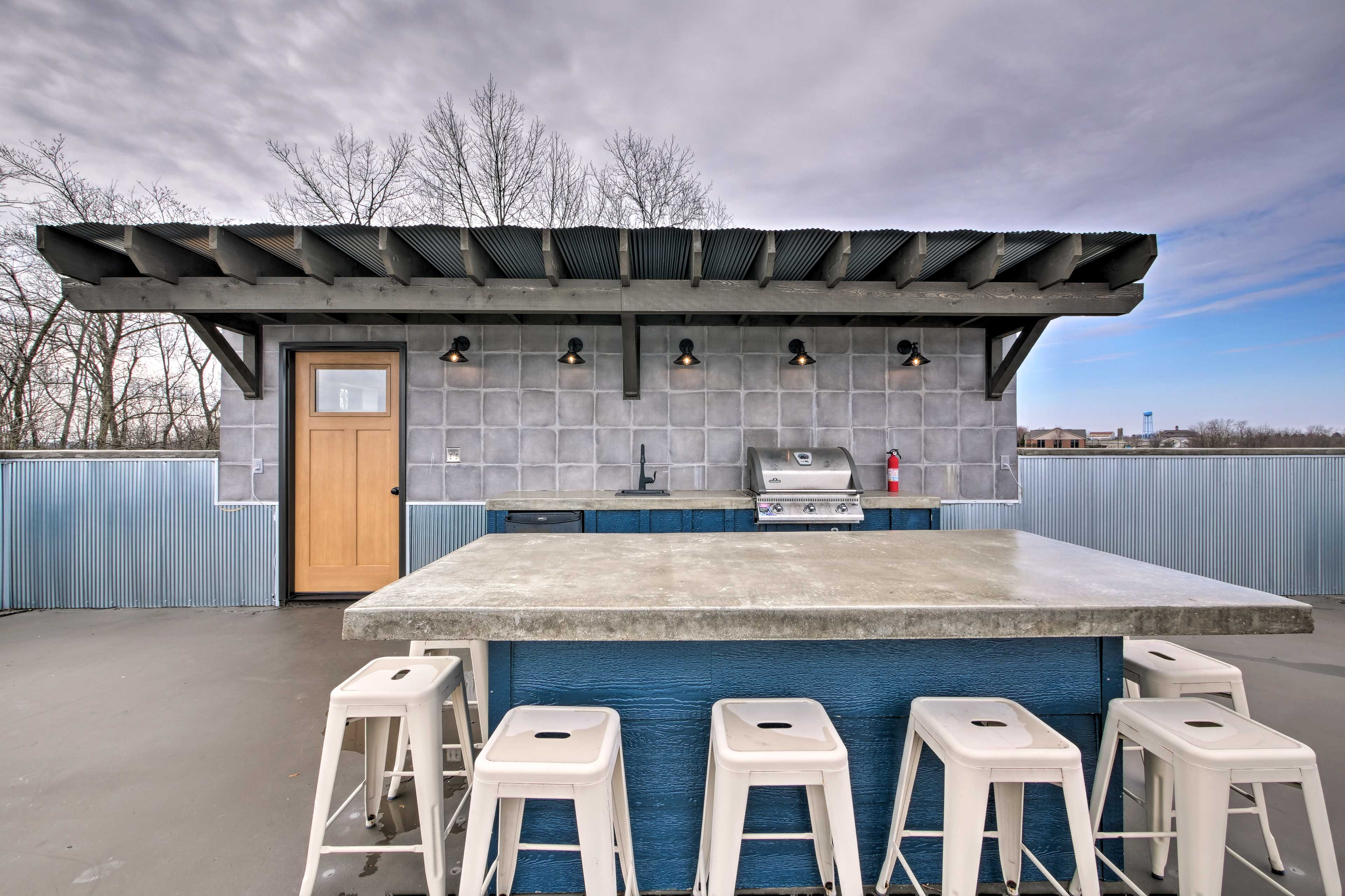 The shared patio has an outdoor kitchen.