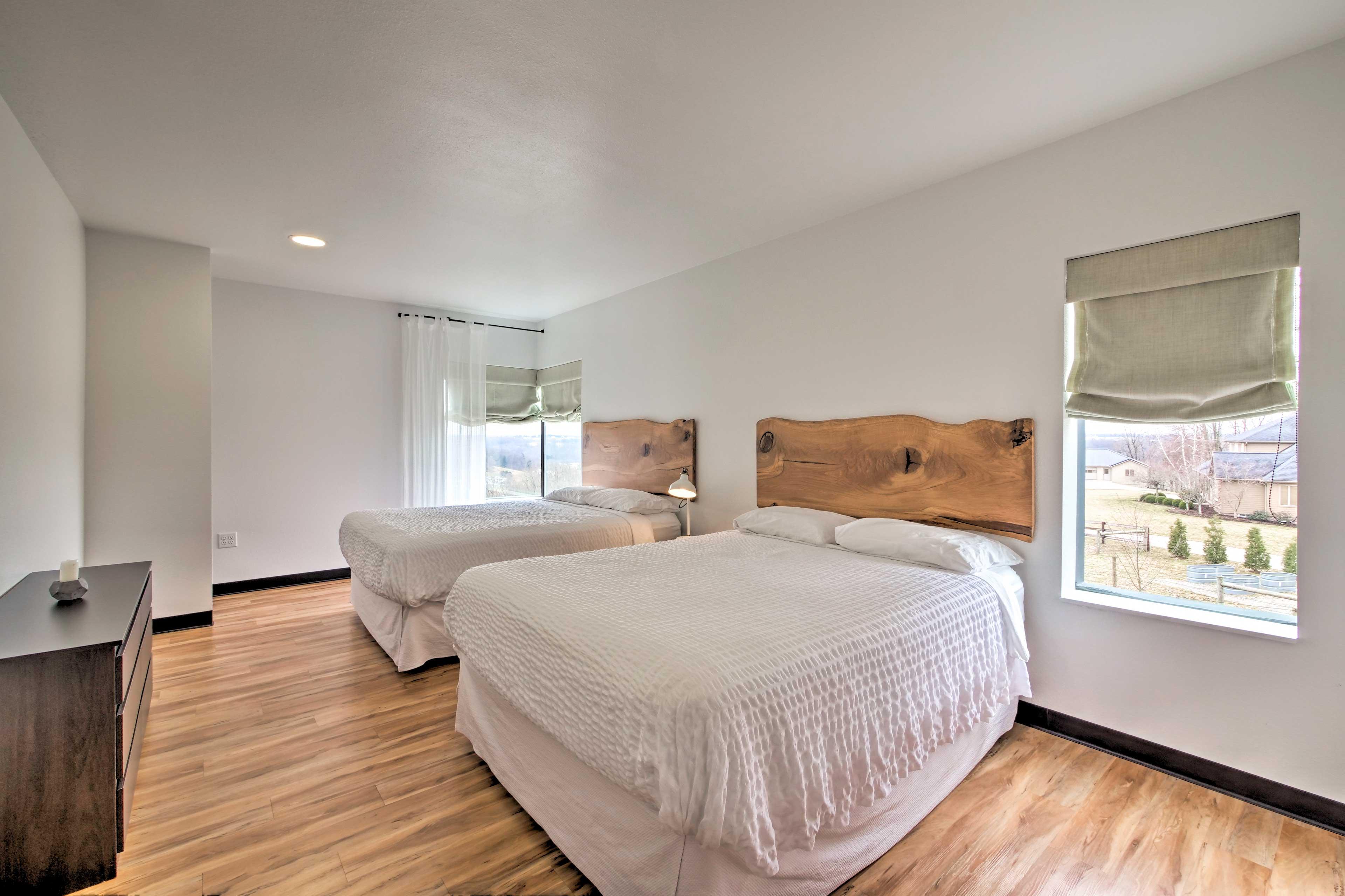 This bedroom has 2 queen beds.