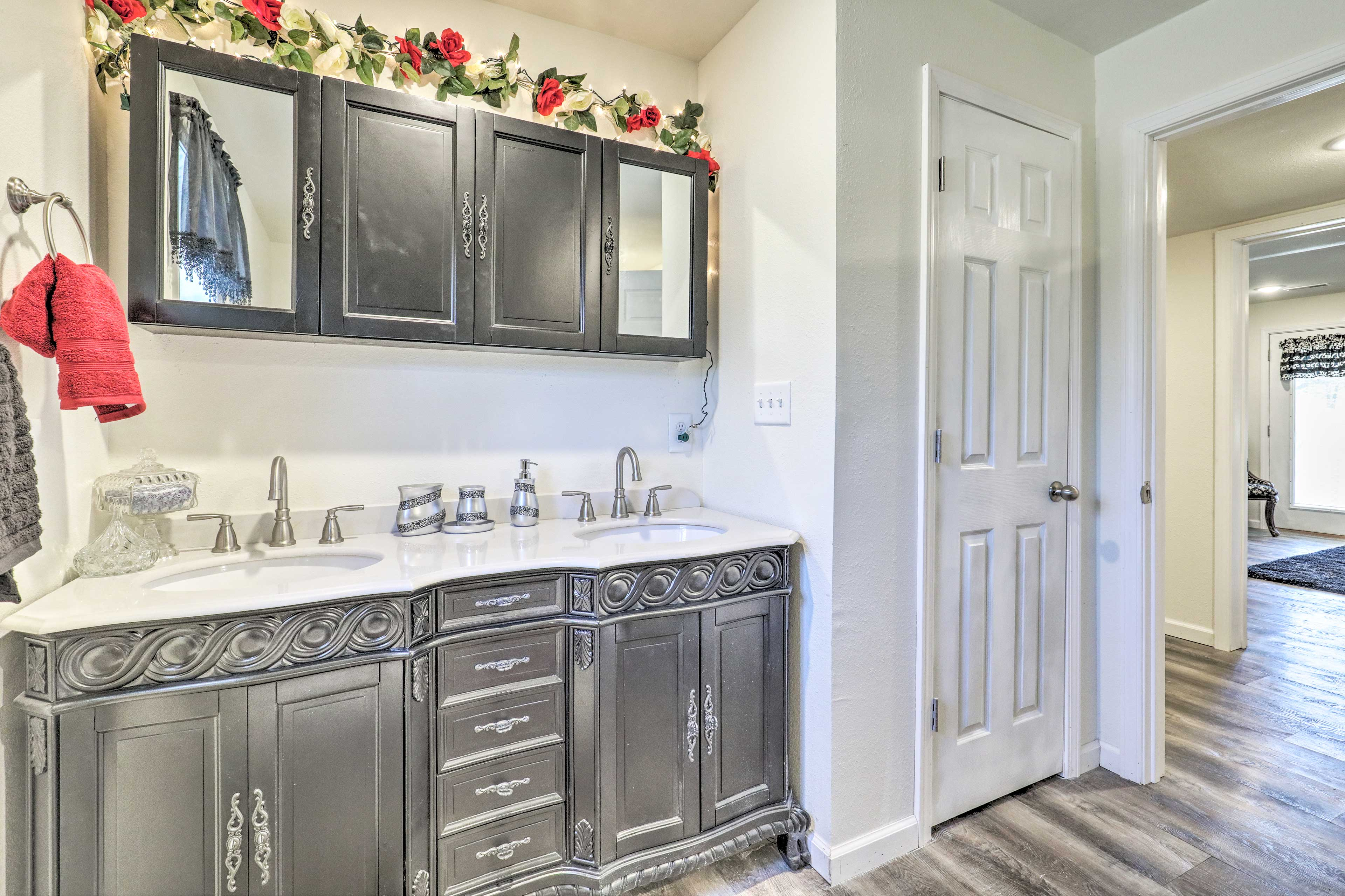 The elegant bathroom boasts a double vanity.