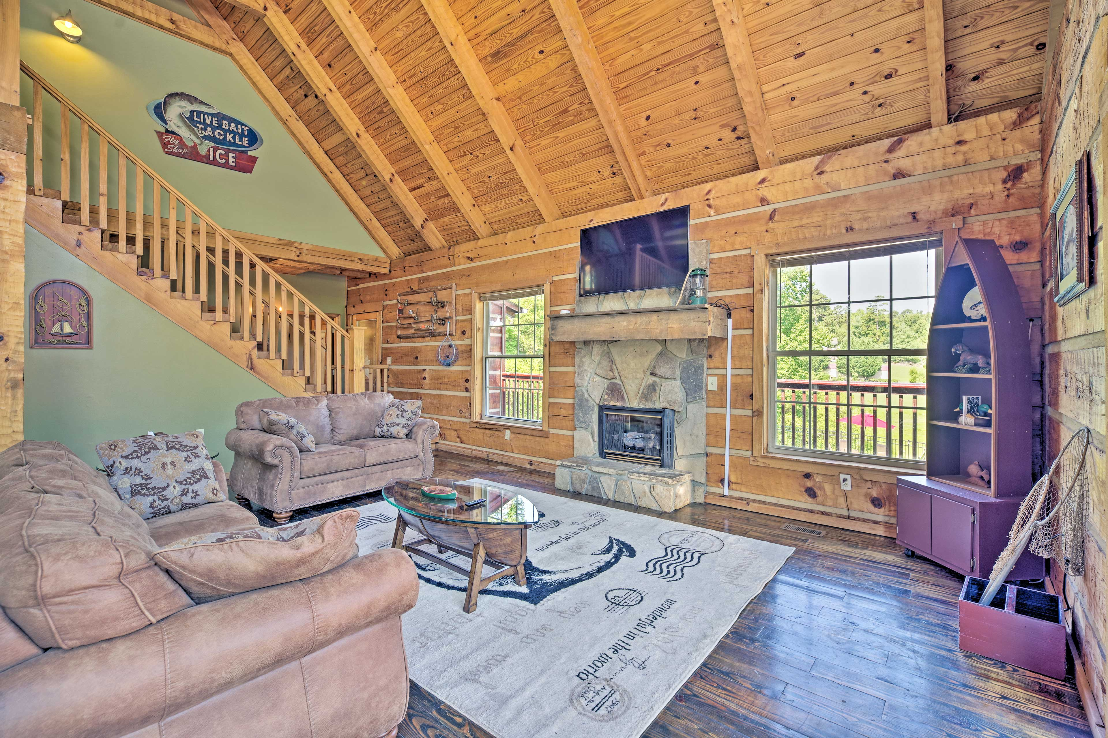 The living room hosts a flat-screen Smart TV and cozy fireplace.