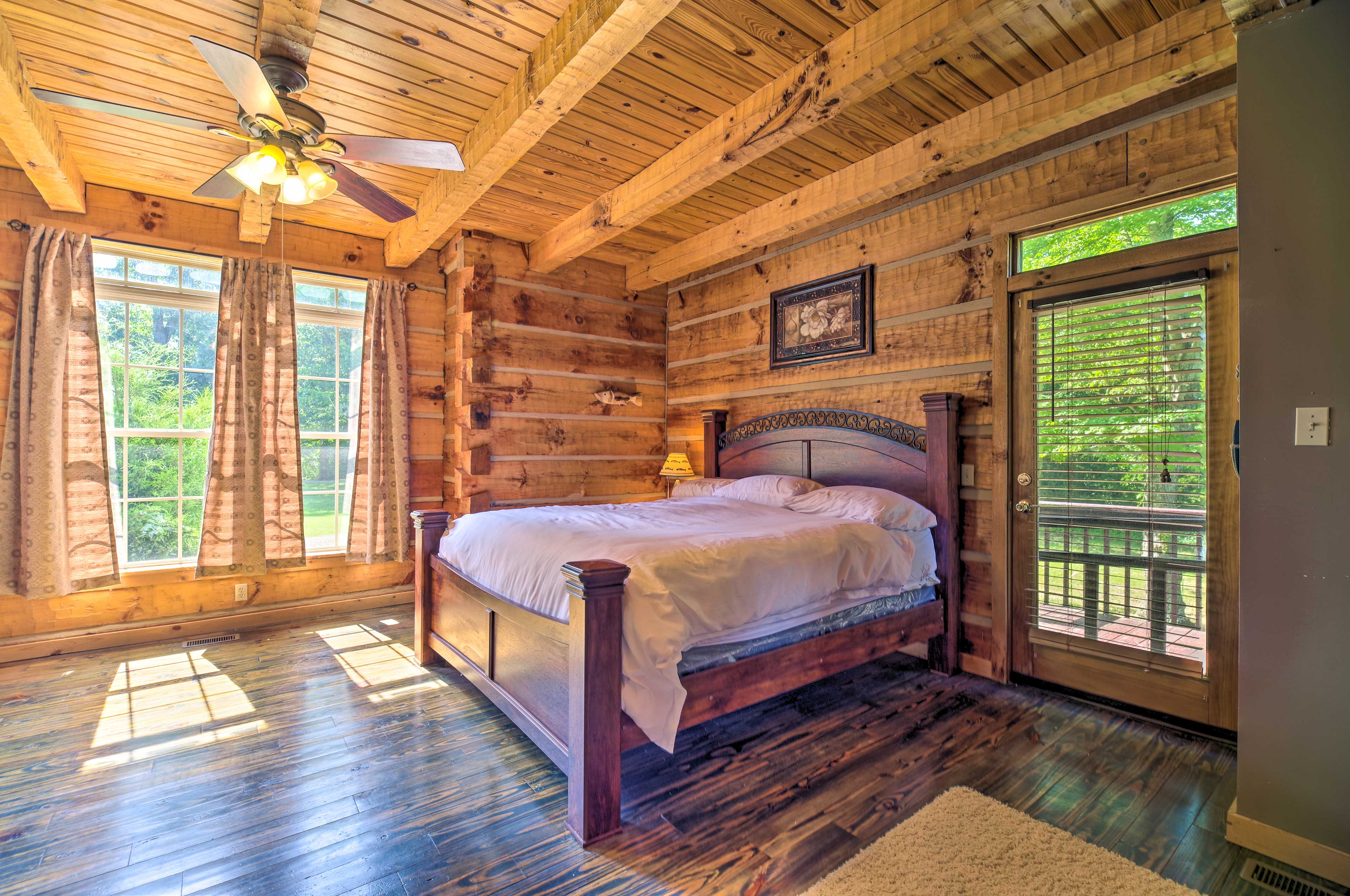 The master bedroom is home to high ceilings and a king bed.