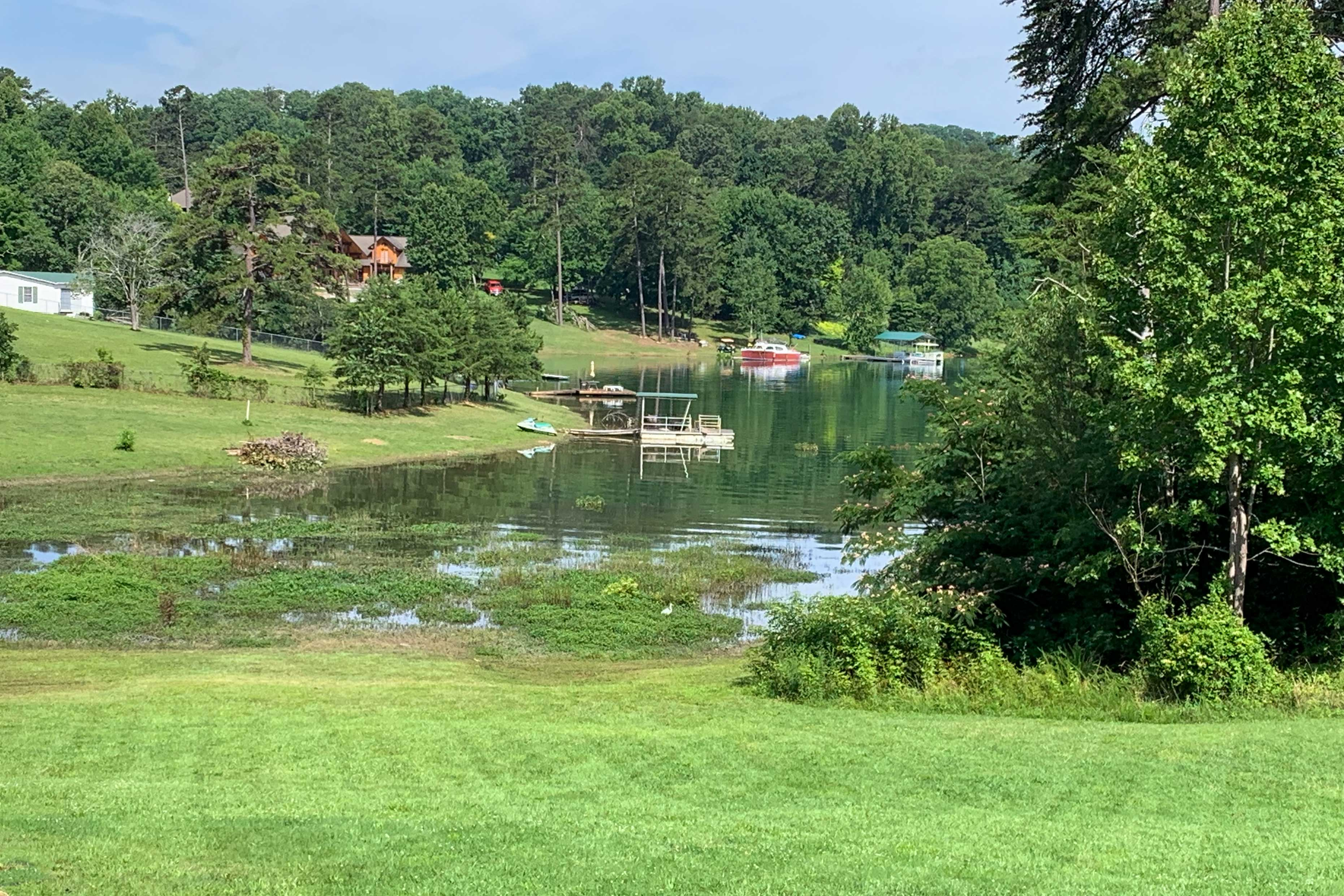 The lake is located just down from the home!