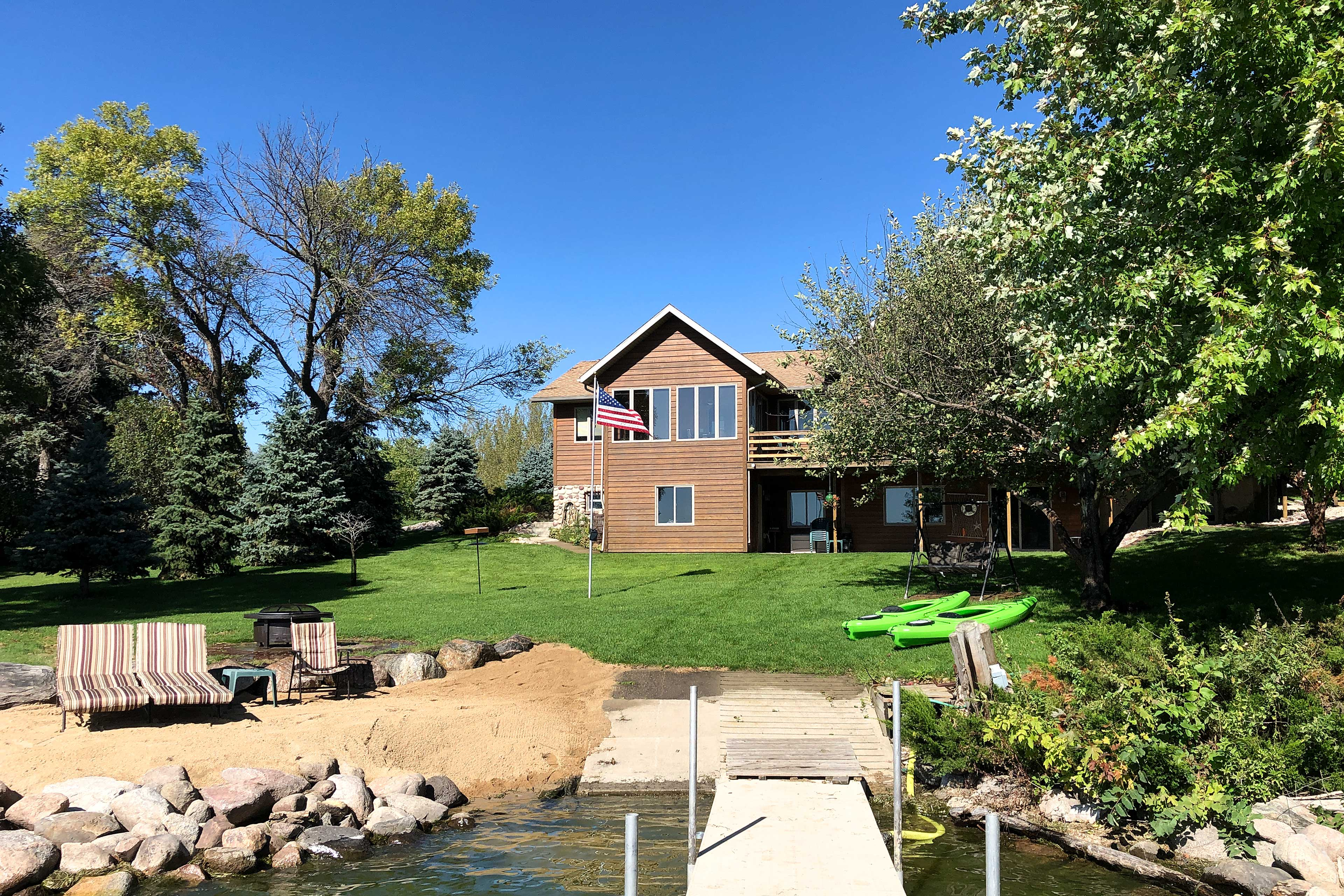 Enjoy lakefront living at its best with all the perks of this rental home.