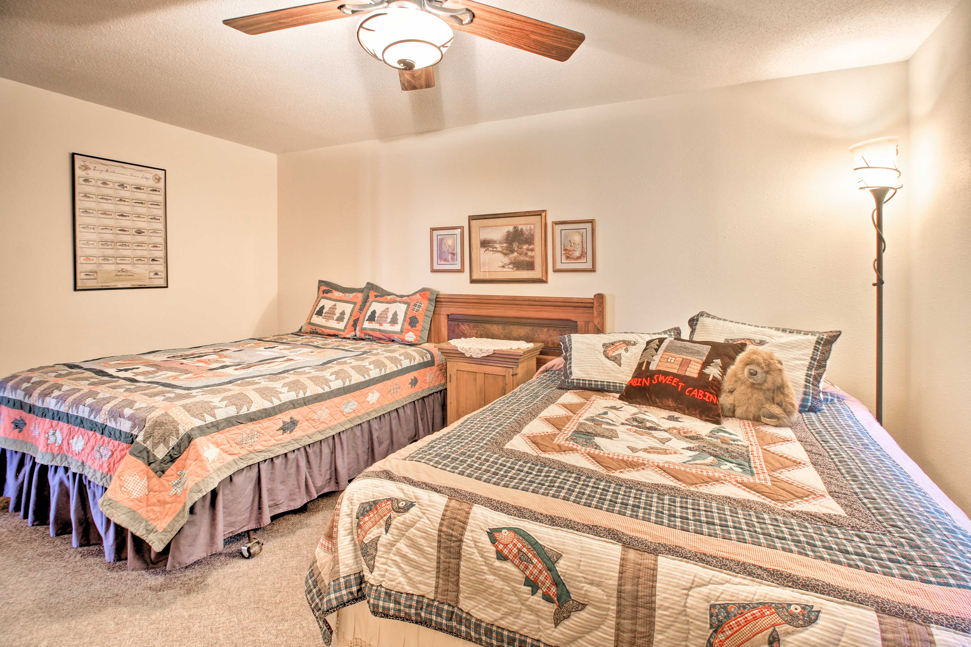 This third bedroom boasts 2 queen beds as well!