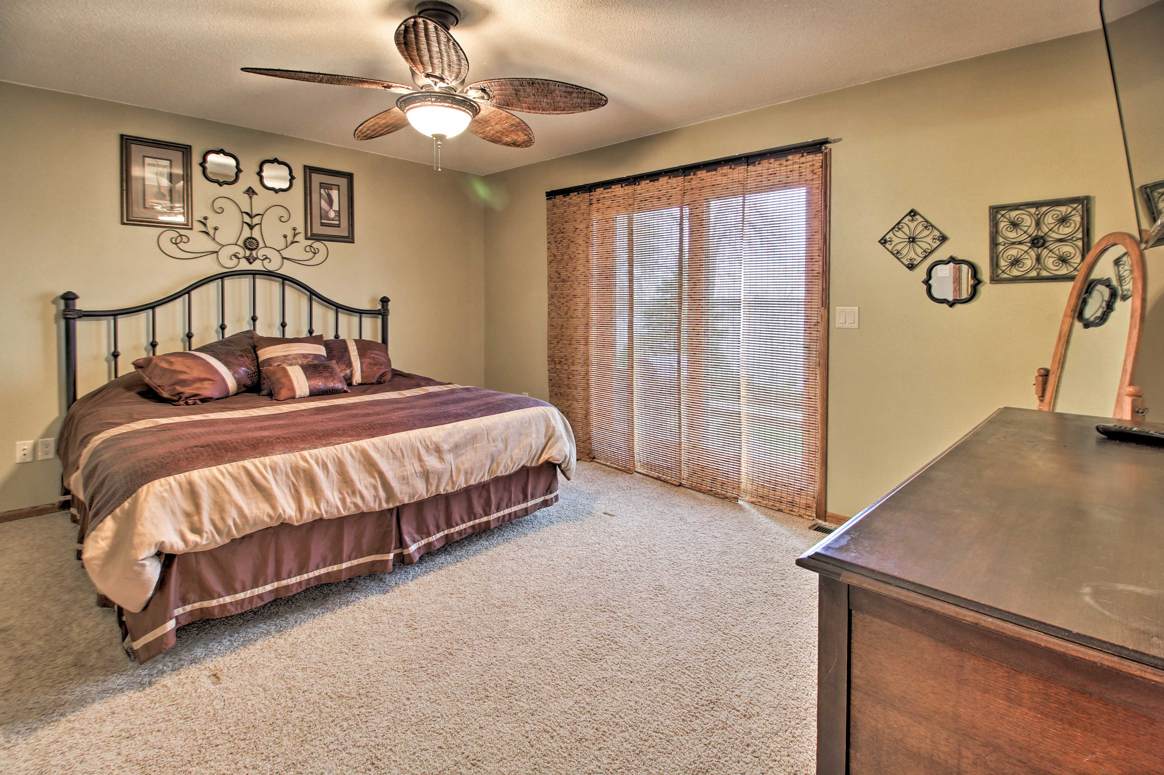 The master bedroom hosts a king bed and deck access.