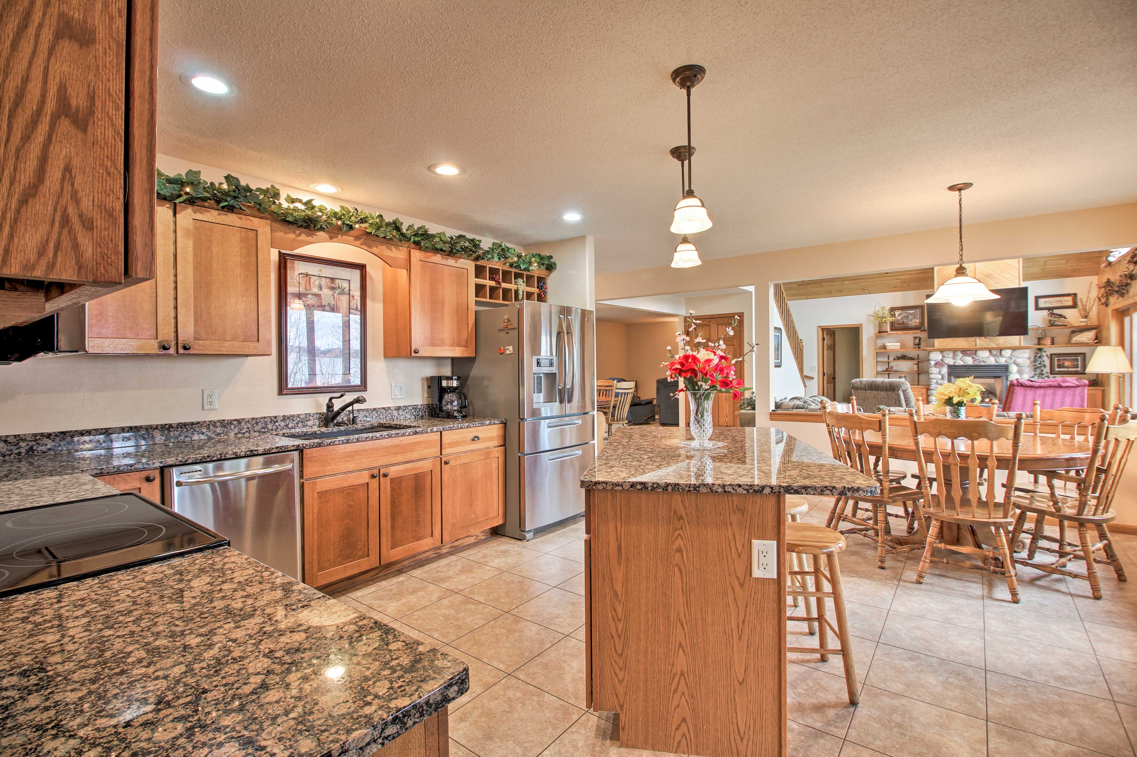 Granite counters and stainless steel appliances furnish the kitchen in style!