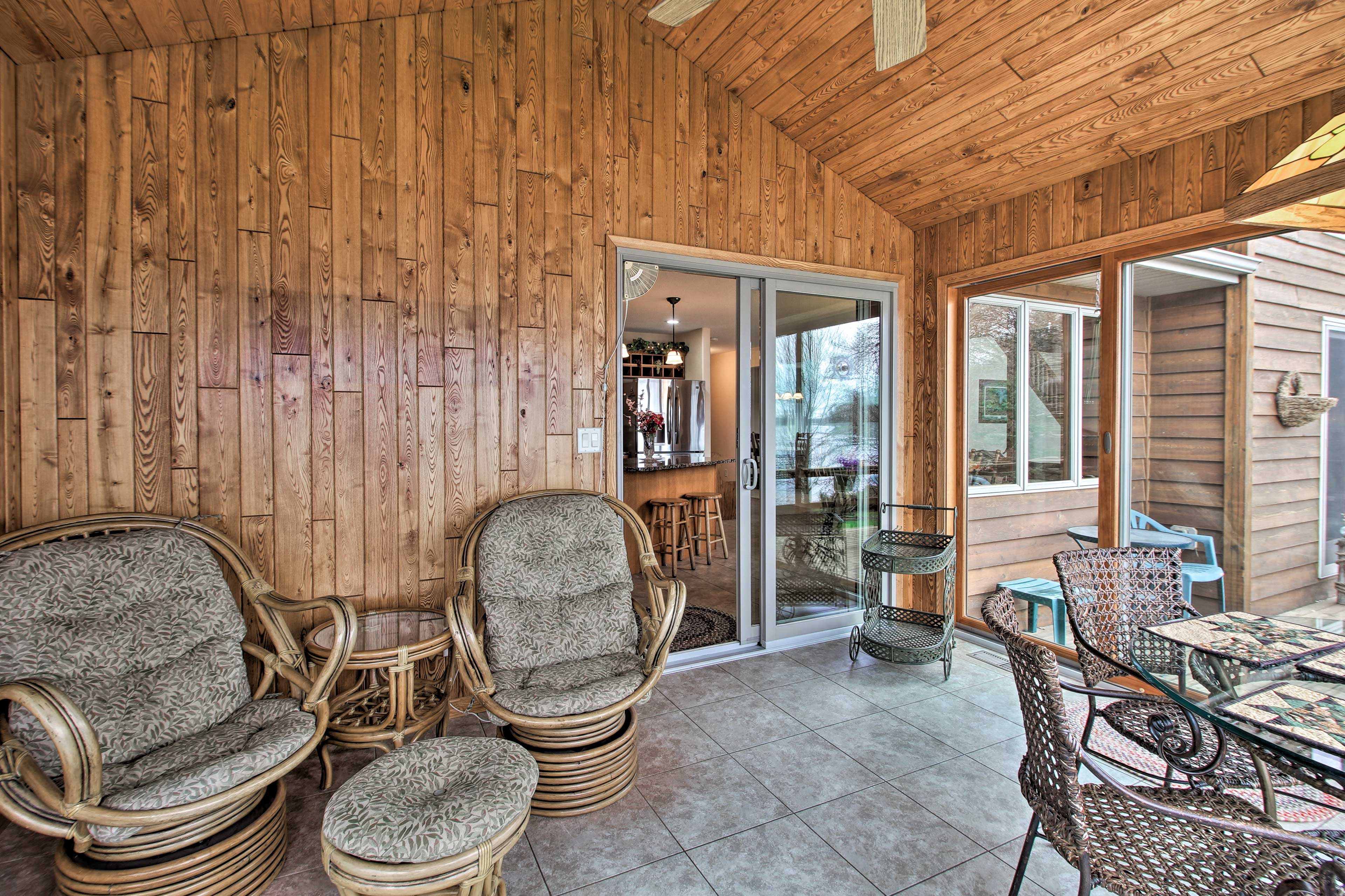 A furnished sunroom is accessible just off of the kitchen!