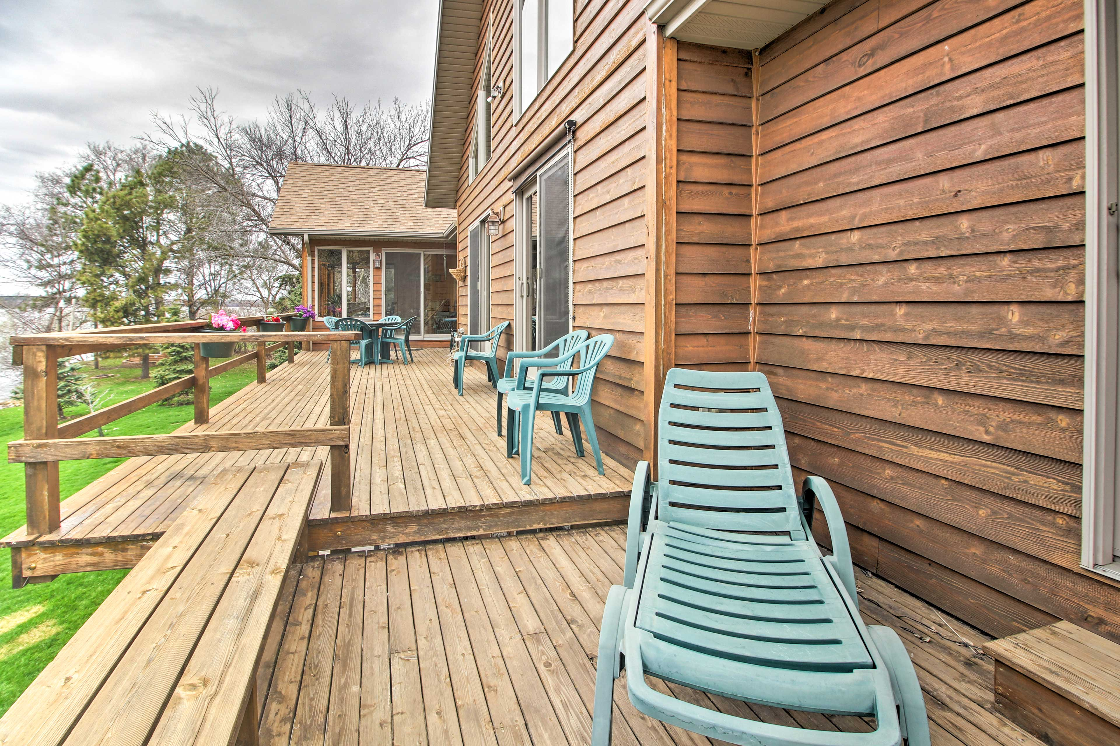 The furnished deck features a chaise lounge and seating for the whole group!