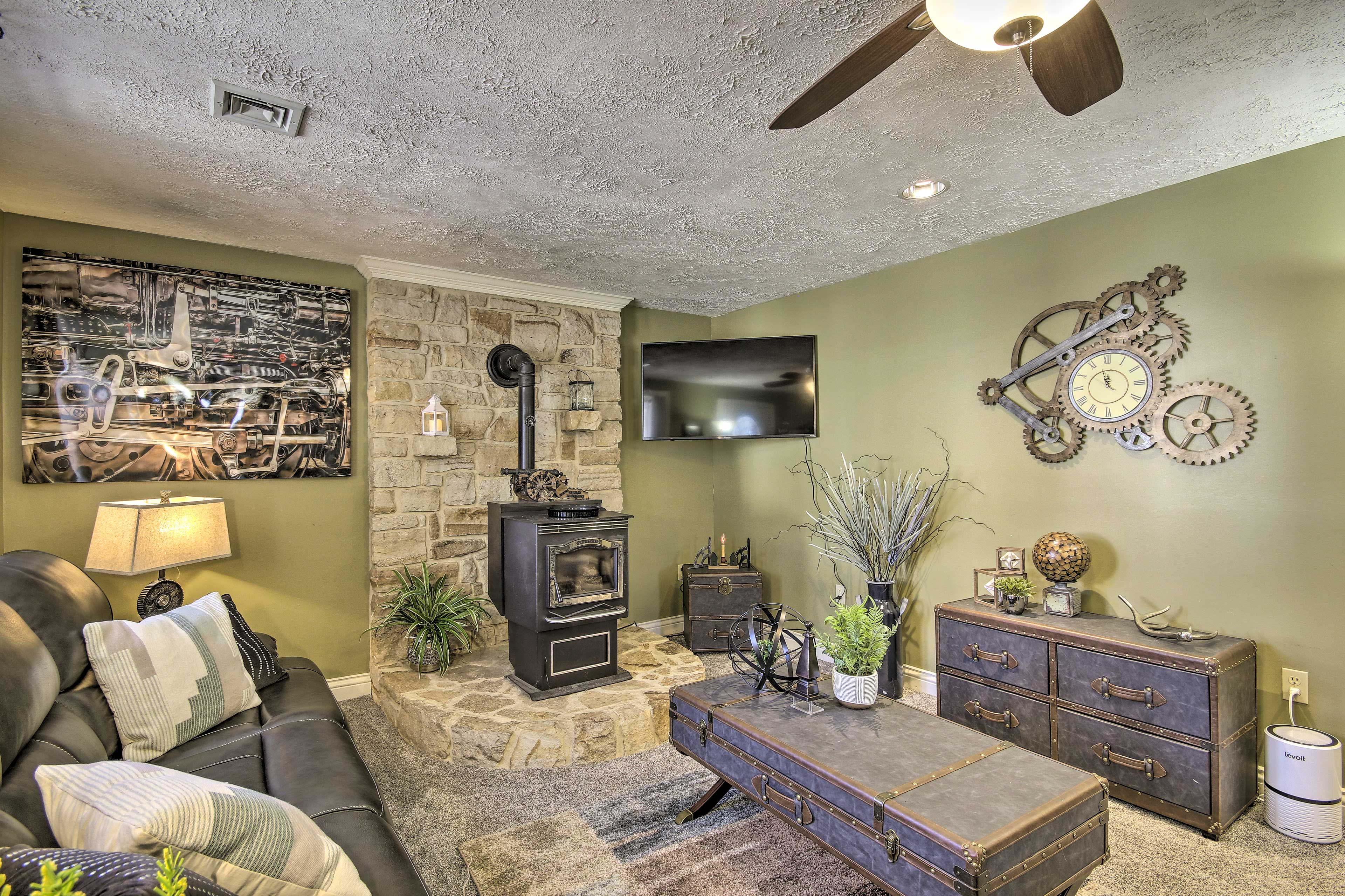 Unwind in the contemporary living space featuring a wood-burning stove.