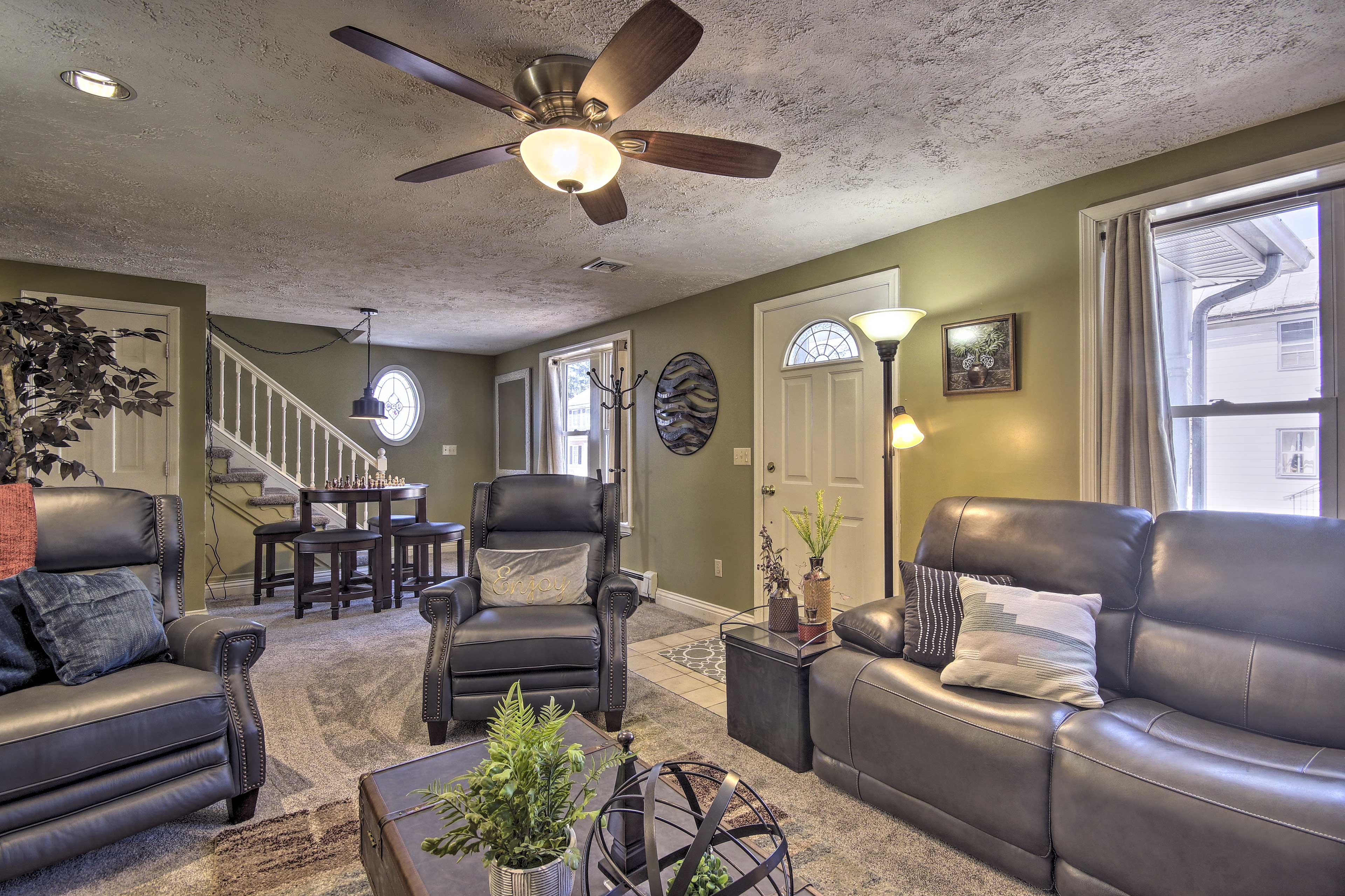 Kick back on leather furnishings as family favorites play on the flat-screen TV.